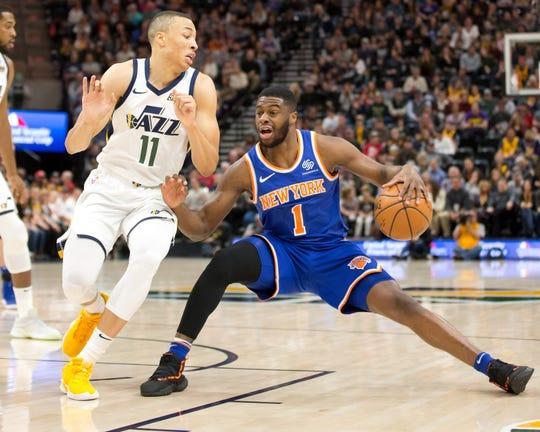 Dec 29, 2018; Salt Lake City, UT, USA; New York Knicks guard Emmanuel Mudiay (1) dribbles the ball as Utah Jazz guard Dante Exum (11) defends during the first quarter at Vivint Smart Home Arena.