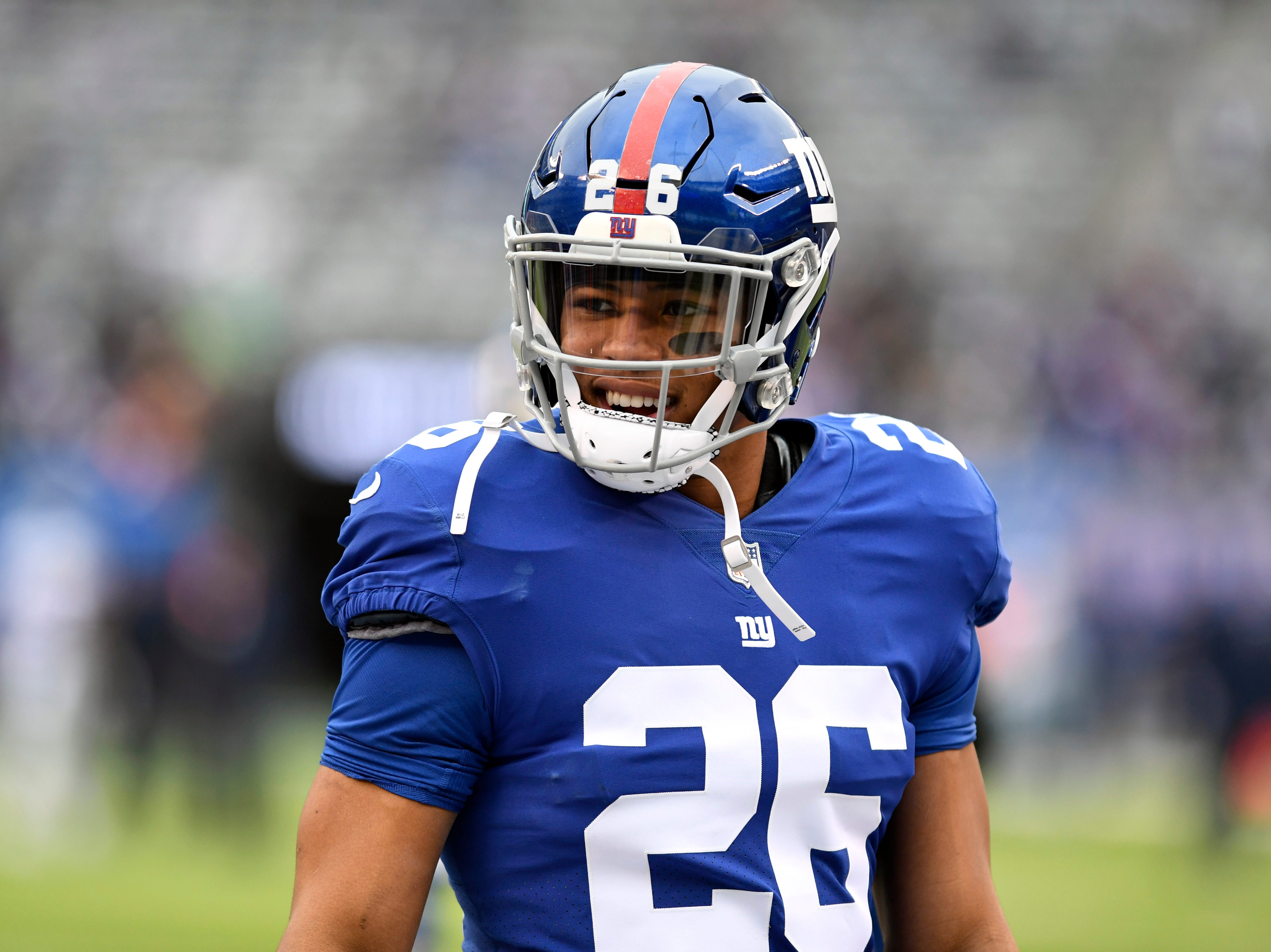 New York Giants running back Saquon Barkley (26) smiles towards his family on the sideline during warmups. The New York Giants face the Dallas Cowboys in the last regular season game on Sunday, Dec. 30, 2018, in East Rutherford.