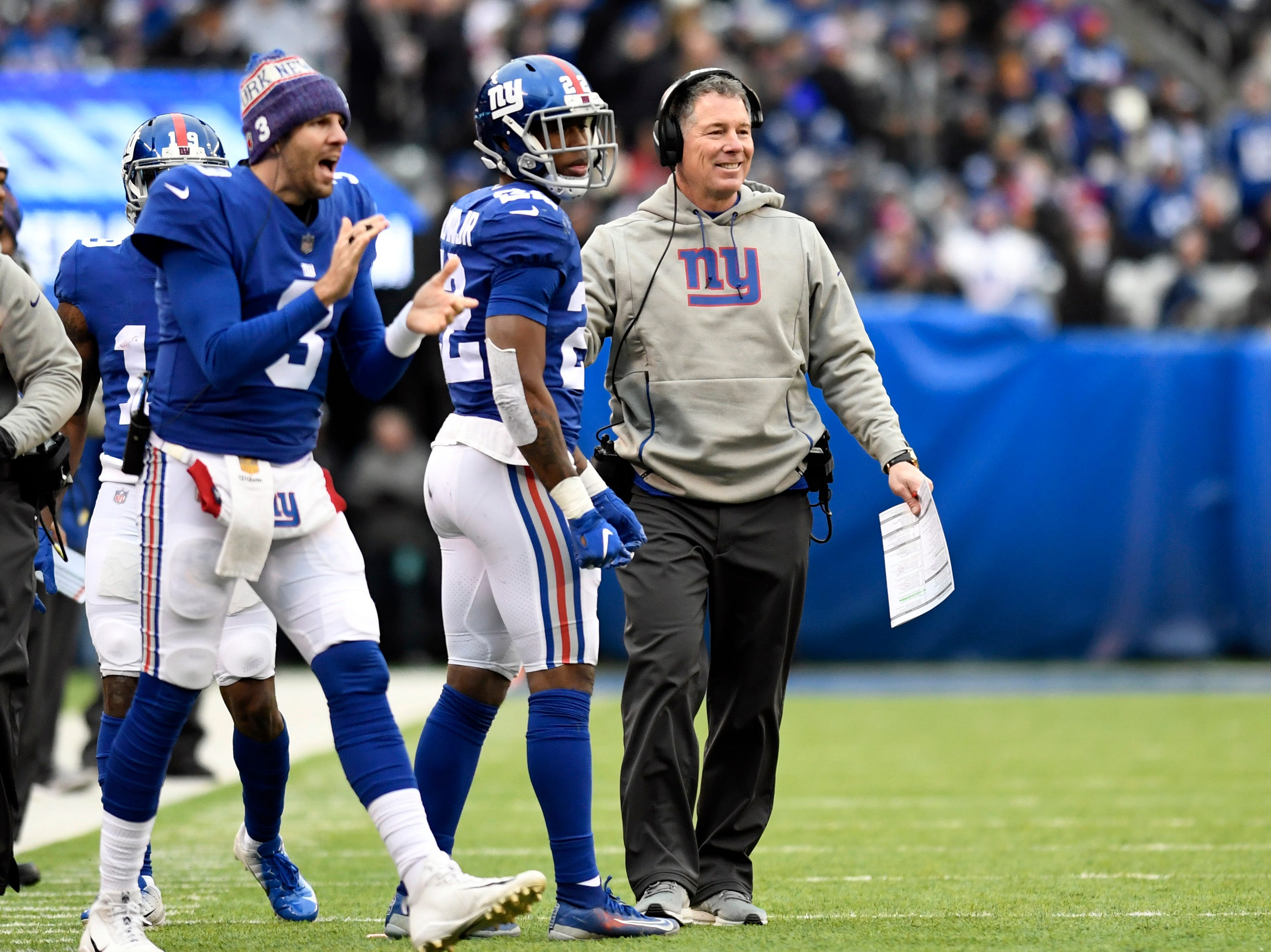 New York Giants head coach Pat Shurmur, far right, smiles after the Giants score a touchdown to end the first half. The New York Giants face the Dallas Cowboys in the last regular season game on Sunday, Dec. 30, 2018, in East Rutherford.