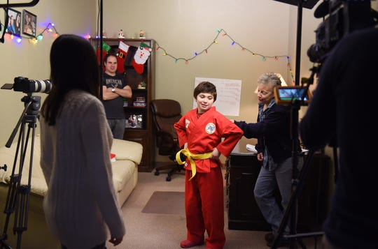 Mario Del Vecchio (age 10) of Midland Park student, acts with Mila Milosevic (L, foreground) who plays as his mother during a rehearsal of a movie as Julie Kimmel (R), Director, directs them while his father Ken Del Vecchio (rear), Writer and Producer who runs the Hoboken Film Festival, looks on, photographed at their shooting location in North Haledon on 12/30/18.