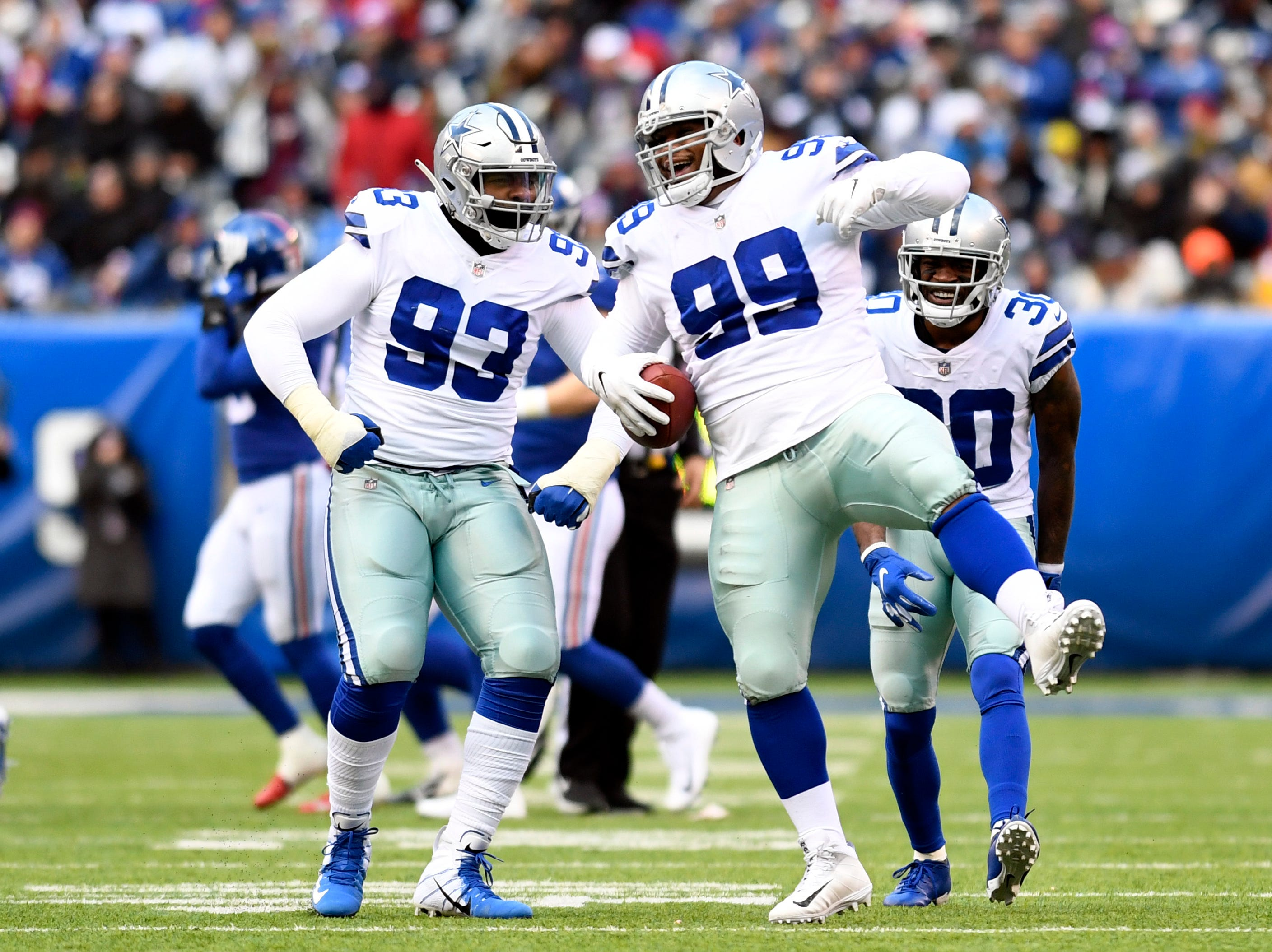 Dallas Cowboys defensive tackle Antwaun Woods (99) celebrates an interception in the first half. The New York Giants face the Dallas Cowboys in the last regular season game on Sunday, Dec. 30, 2018, in East Rutherford.