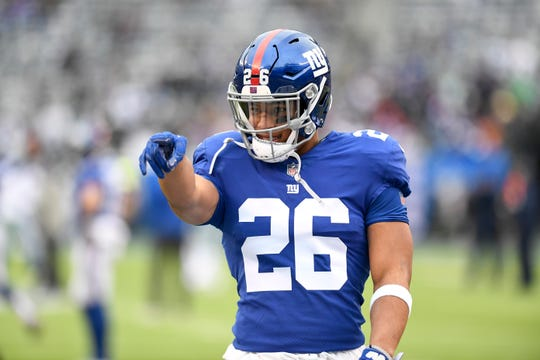 New York Giants running back Saquon Barkley (26) points to his family on the sideline during warmups. The New York Giants face the Dallas Cowboys in the last regular season game on Sunday, Dec. 30, 2018, in East Rutherford.