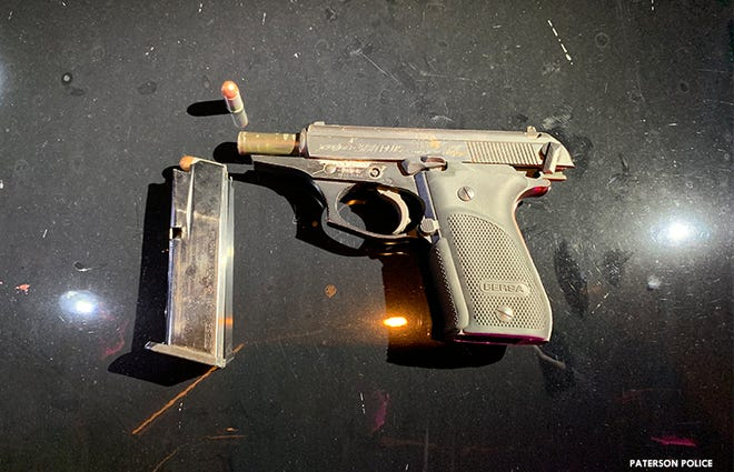 Paterson police said this gun was recovered after chasing a suspect early Sunday morning.