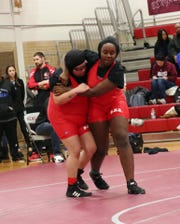 Bloomfield's Angelina Faura (left) and Jordyn Parker wrestled each other in an upper-bracket bout.