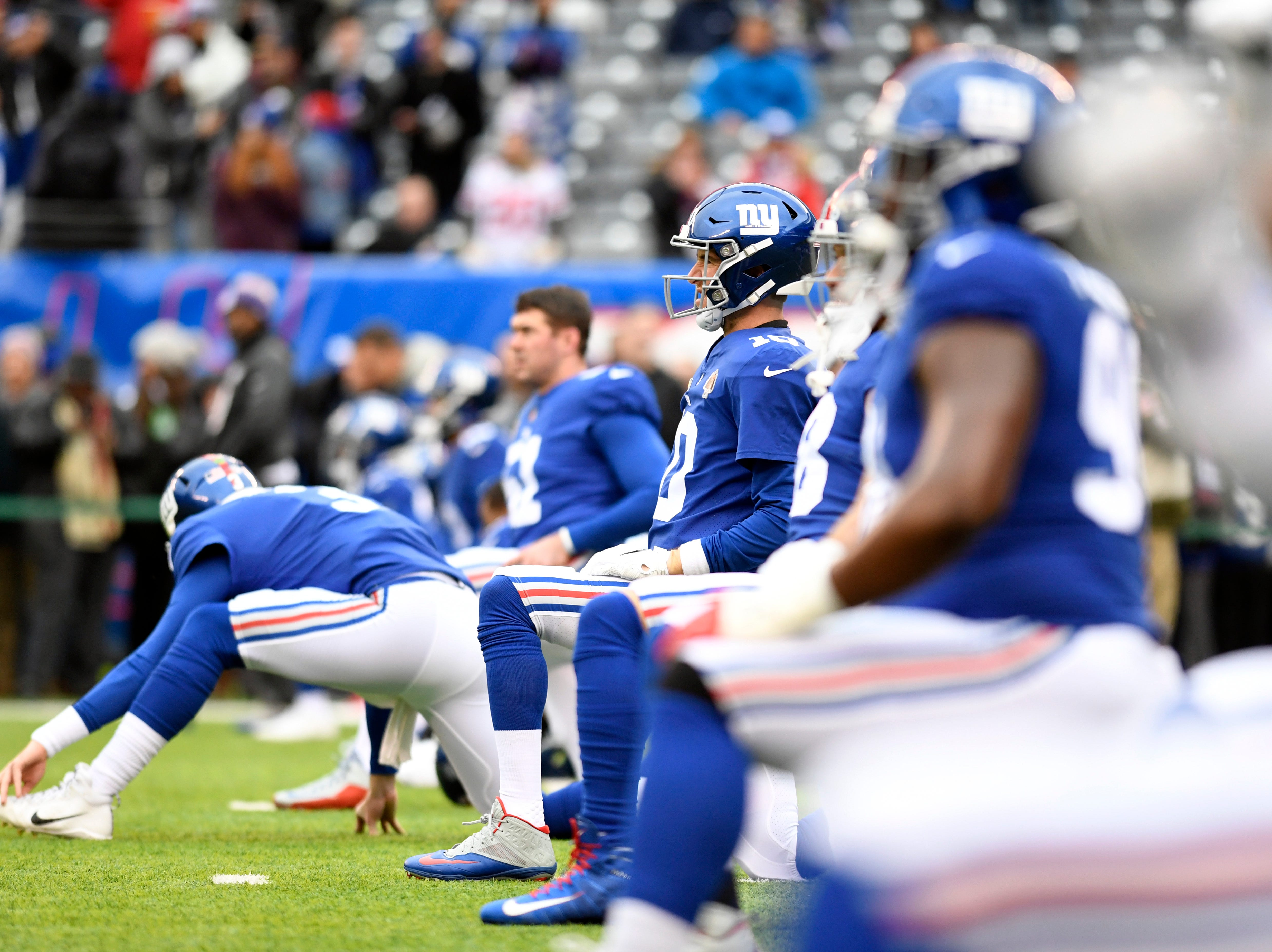 New York Giants quarterback Eli Manning and the Giants stretch before facing the Dallas Cowboys in the last regular season game on Sunday, Dec. 30, 2018, in East Rutherford.