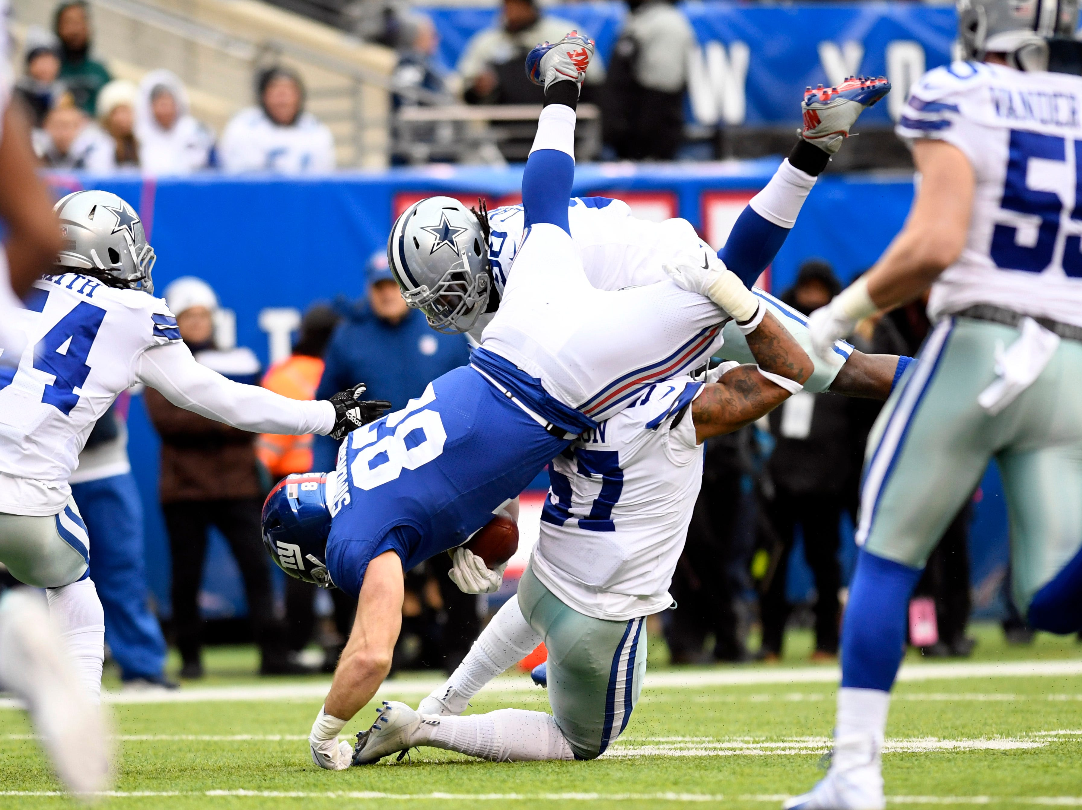 New York Giants tight end Scott Simonson (82) flips over Dallas Cowboys outside linebacker Damien Wilson (57) in the first half. The New York Giants face the Dallas Cowboys in the last regular season game on Sunday, Dec. 30, 2018, in East Rutherford.