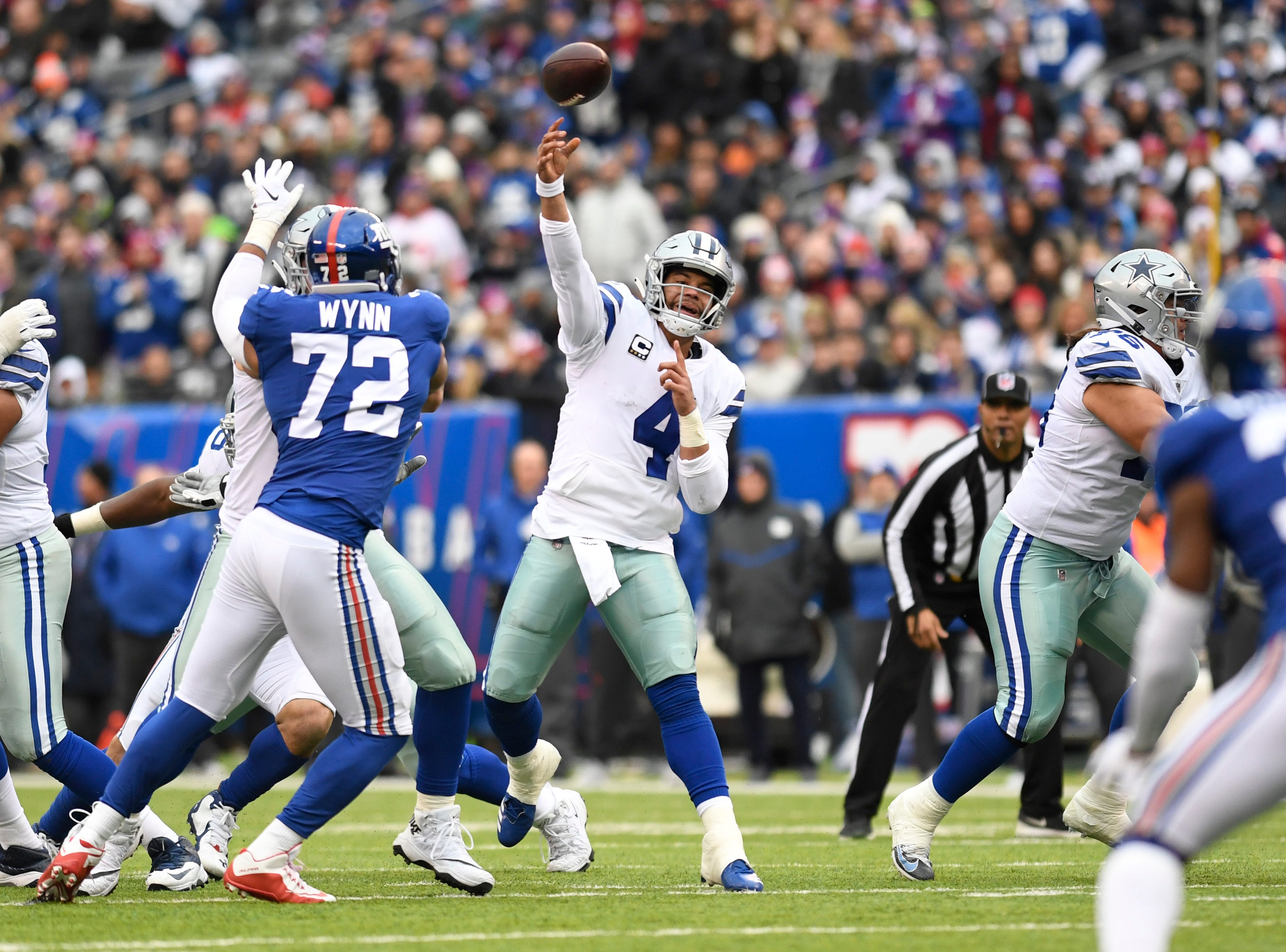 Dallas Cowboys quarterback Dak Prescott (4) throws a touchdown pass in the first half. The New York Giants face the Dallas Cowboys in the last regular season game on Sunday, Dec. 30, 2018, in East Rutherford.