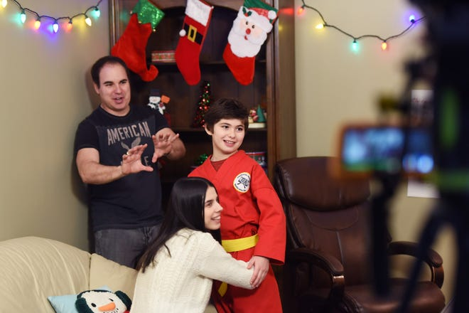 Mario Del Vecchio (age 10) of Midland Park student, acts with Mila Milosevic (in white) who plays as his mother during a rehearsal of a movie as his father Ken Del Vecchio (L), Writer and Producer who runs the Hoboken Film Festival, interacts with them, photographed at their shooting location in North Haledon on 12/30/18.