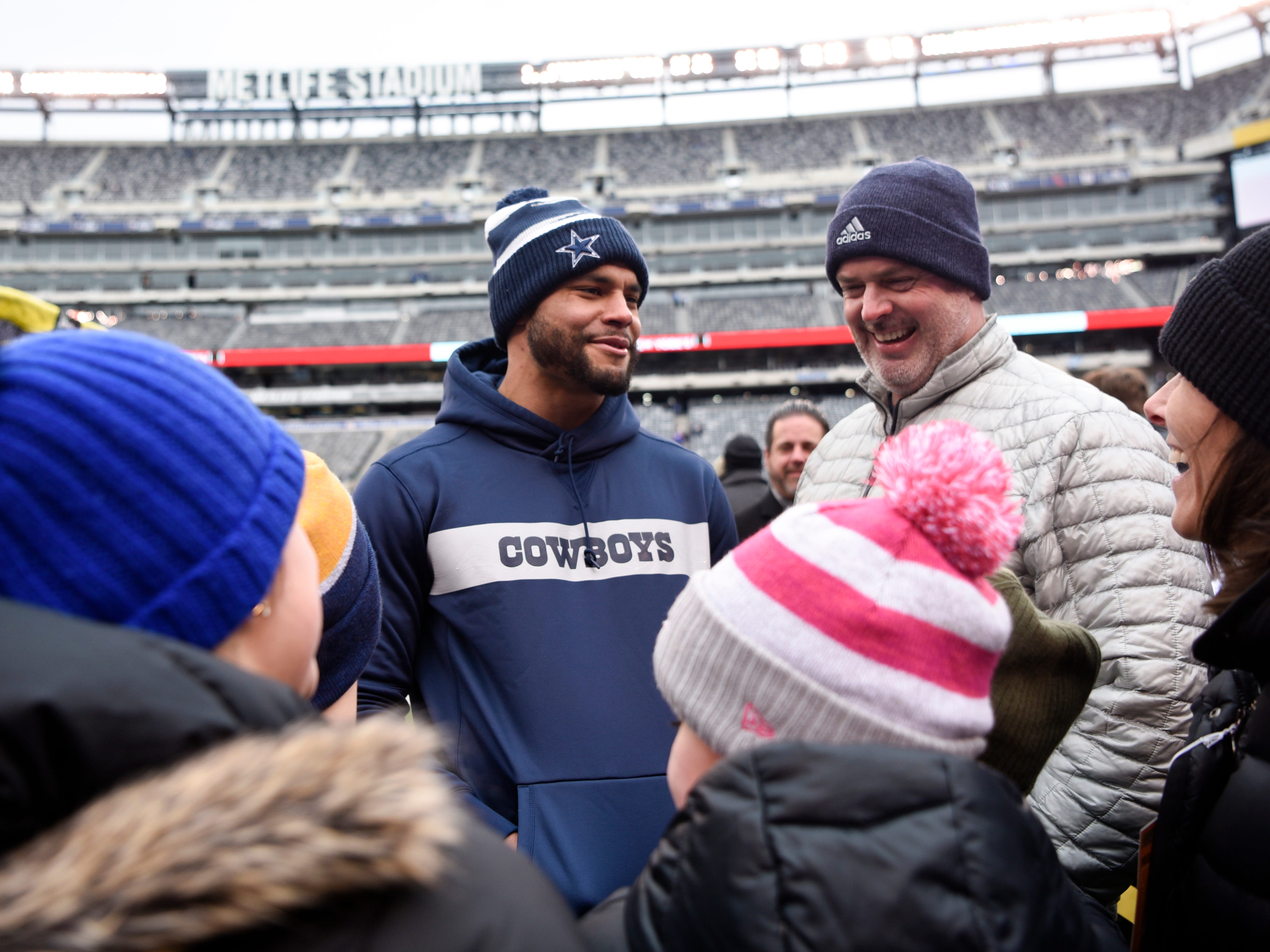Dallas Cowboys quarterback Dak Prescott (4) walks to fans during warmups. The New York Giants face the Dallas Cowboys in the last regular season game on Sunday, Dec. 30, 2018, in East Rutherford.
