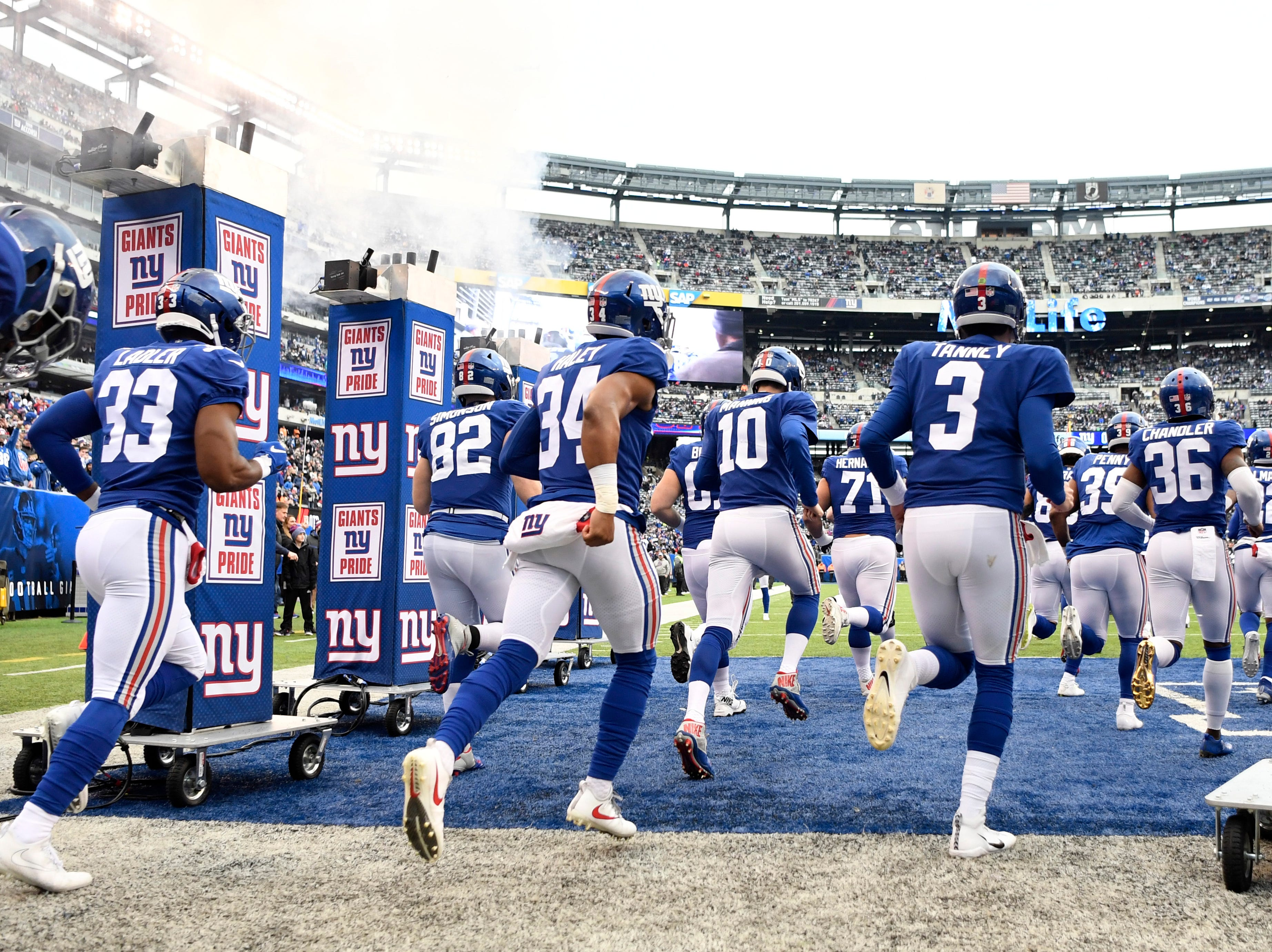 New York Giants quarterback Eli Manning (10) and the Giants take the field to face the Dallas Cowboys in the last regular season game on Sunday, Dec. 30, 2018, in East Rutherford.