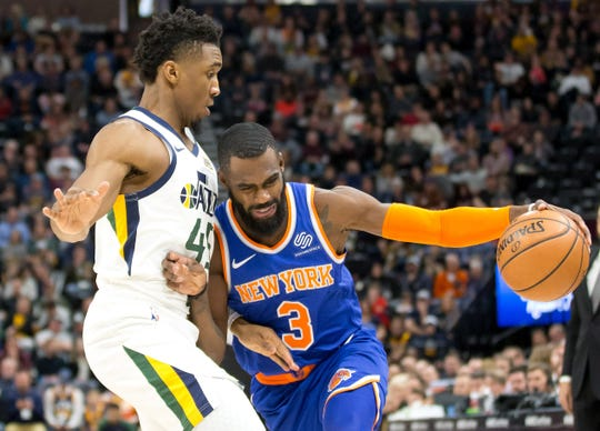 Dec 29, 2018; Salt Lake City, UT, USA; Utah Jazz guard Donovan Mitchell (45) defends against New York Knicks guard Tim Hardaway Jr. (3) during the first quarter at Vivint Smart Home Arena.