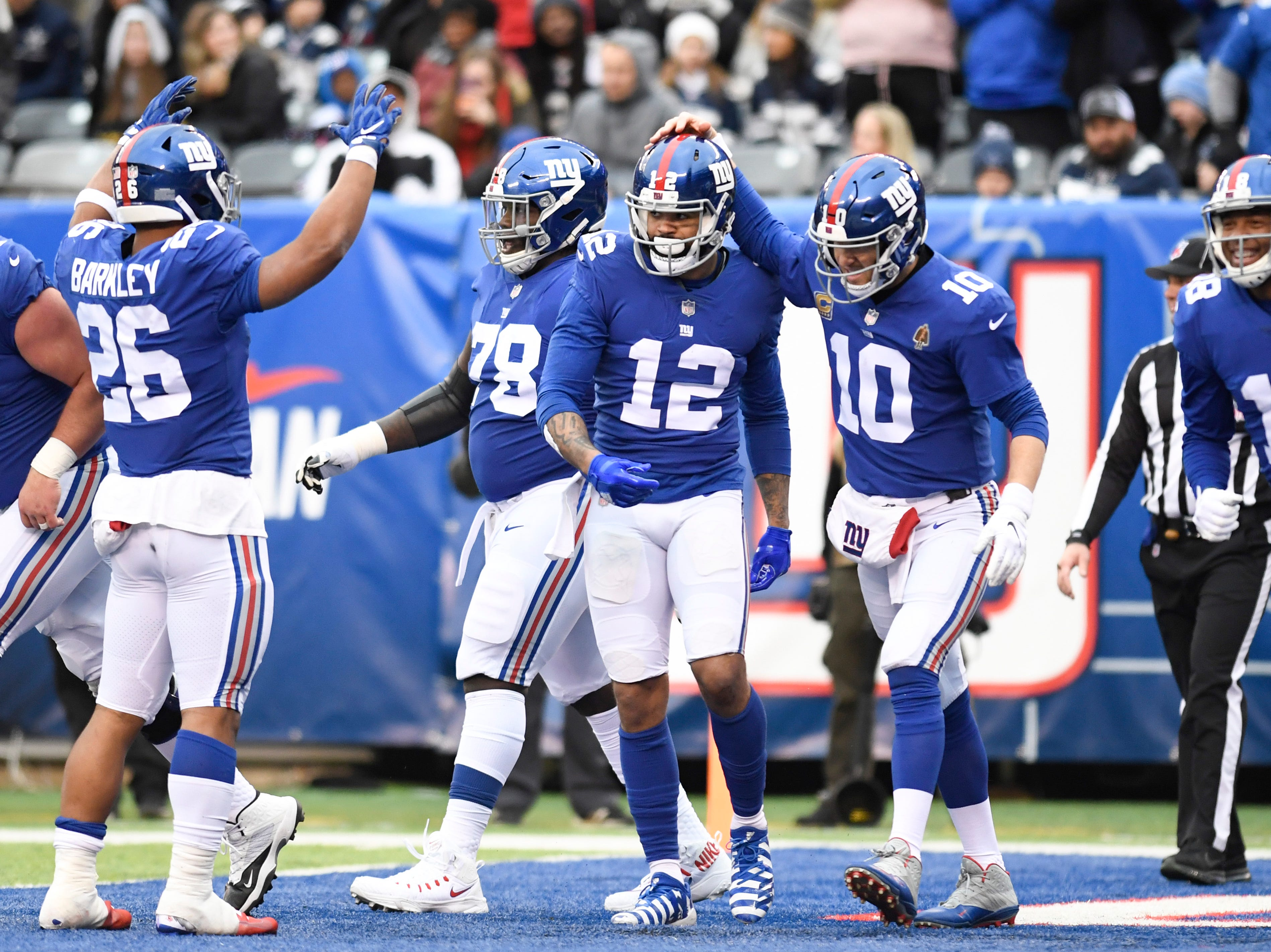 New York Giants quarterback Eli Manning (10) and New York Giants wide receiver Cody Latimer (12) celebrate Latimer's touchdown in the first half. The New York Giants face the Dallas Cowboys in the last regular season game on Sunday, Dec. 30, 2018, in East Rutherford.