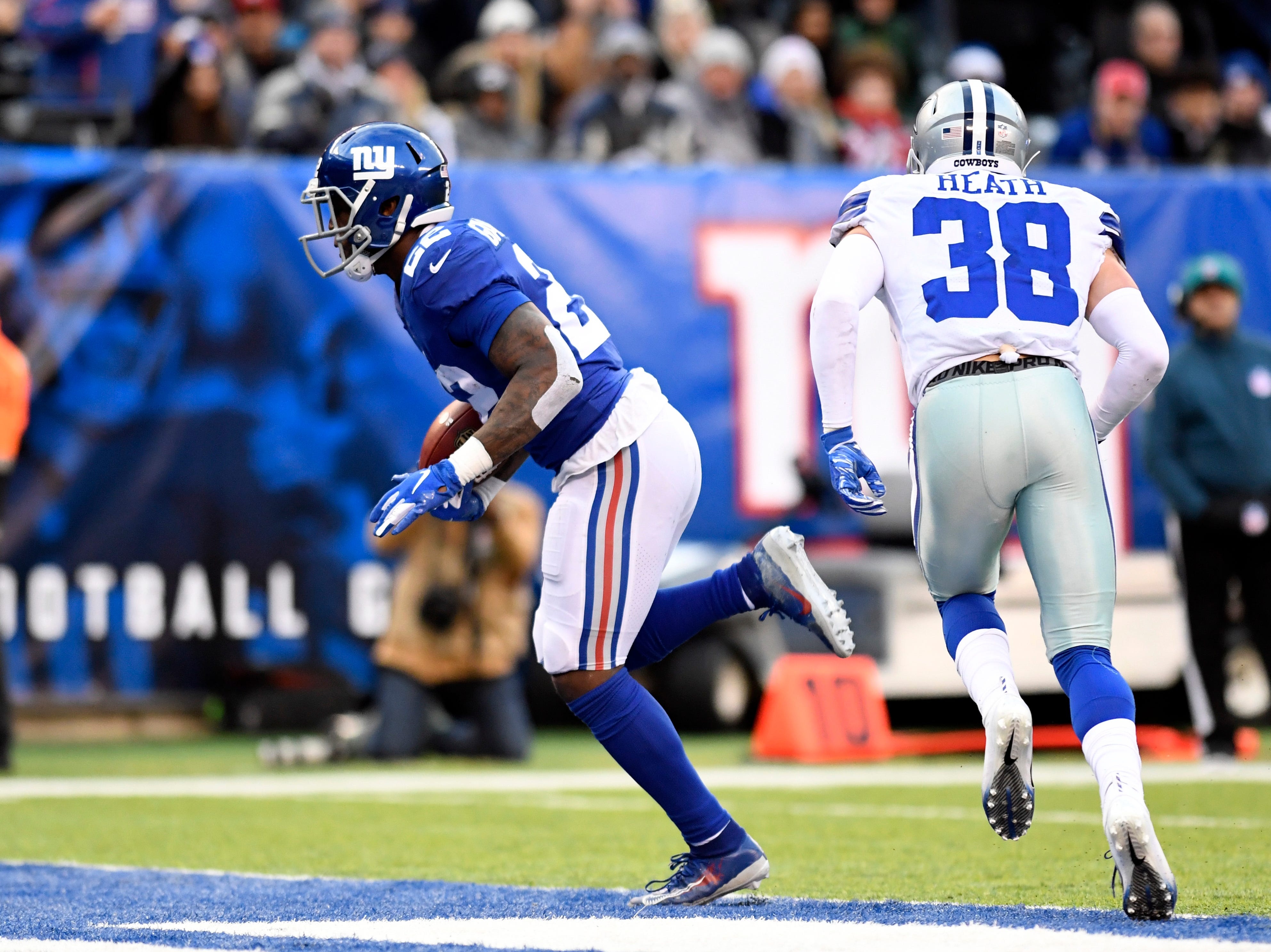 New York Giants running back Wayne Gallman (22) rushes for a touchdown in the fourth quarter. The New York Giants lose to the Dallas Cowboys 36-35 on Sunday, Dec. 30, 2018, in East Rutherford.