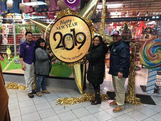 The City of Passaic's first pinata drop scheduled for midnight New Year's Eve weighs 30 pounds, is packed with confetti and be lowered rain or no rain.