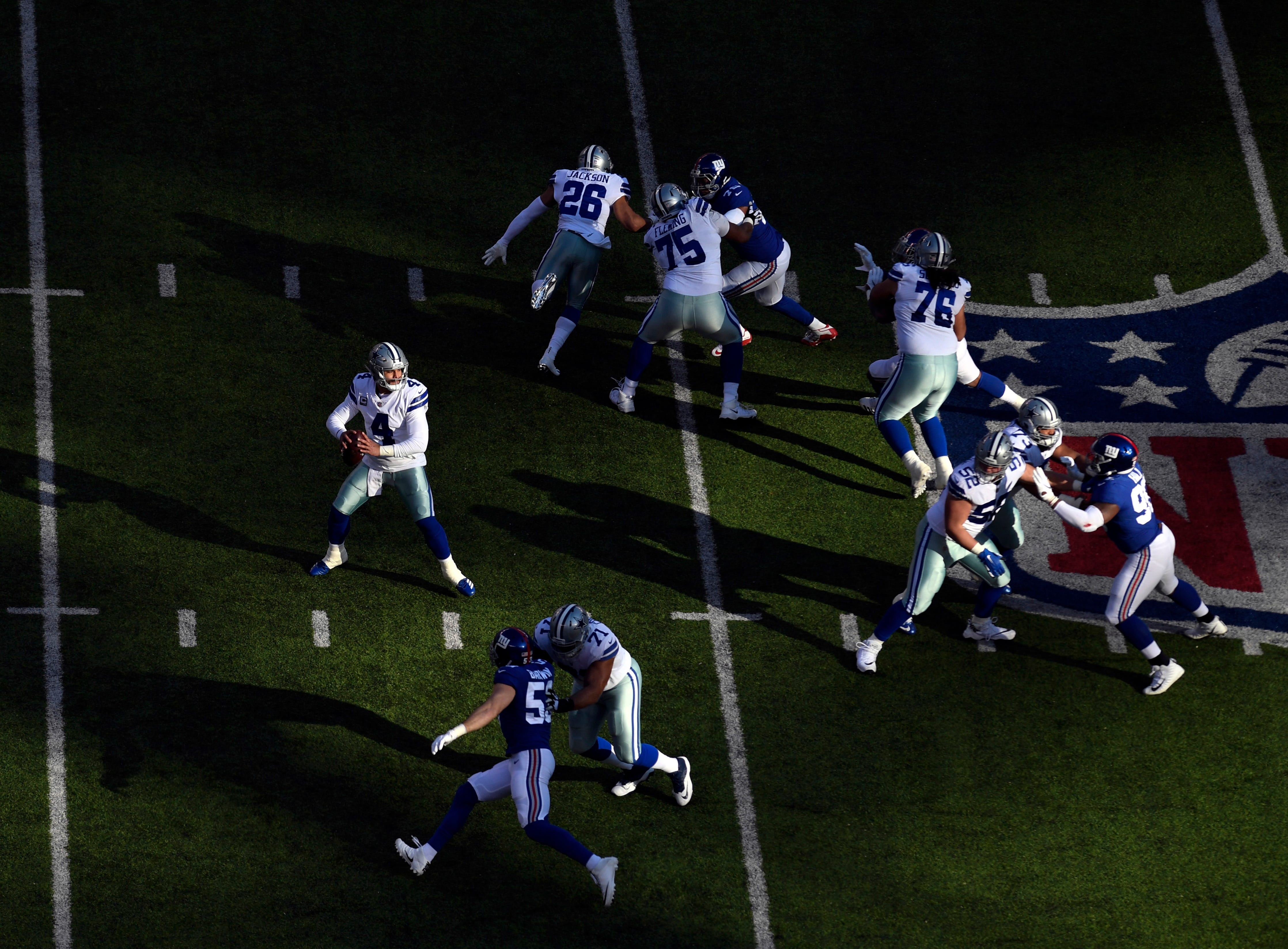 Dallas Cowboys quarterback Dak Prescott (4) and the Cowboys face the New York Giants in the first half on Sunday, Dec. 30, 2018, in East Rutherford.