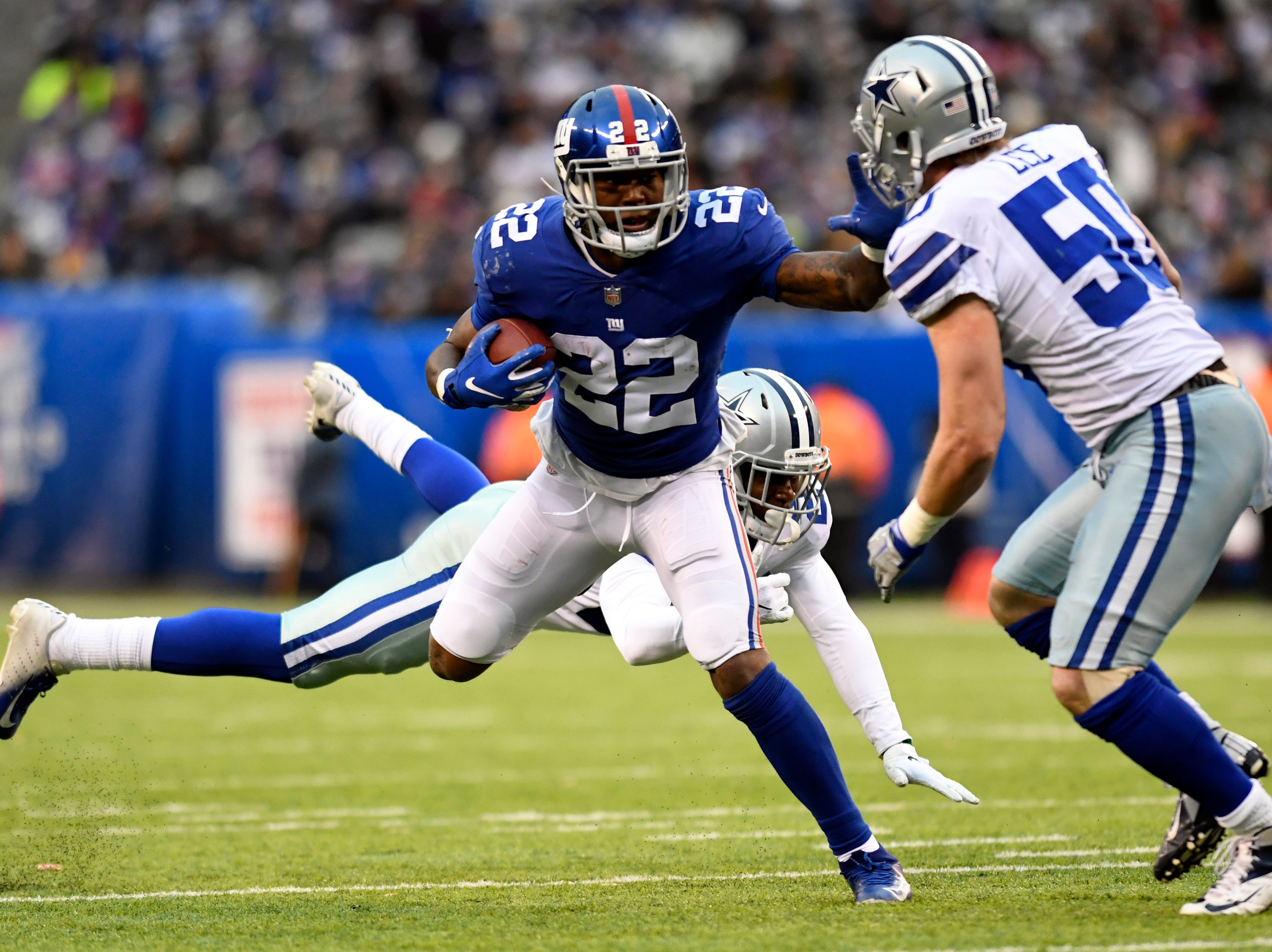 New York Giants running back Wayne Gallman (22) rushes against the Cowboys in the second half. The New York Giants lose to the Dallas Cowboys 36-35 on Sunday, Dec. 30, 2018, in East Rutherford.