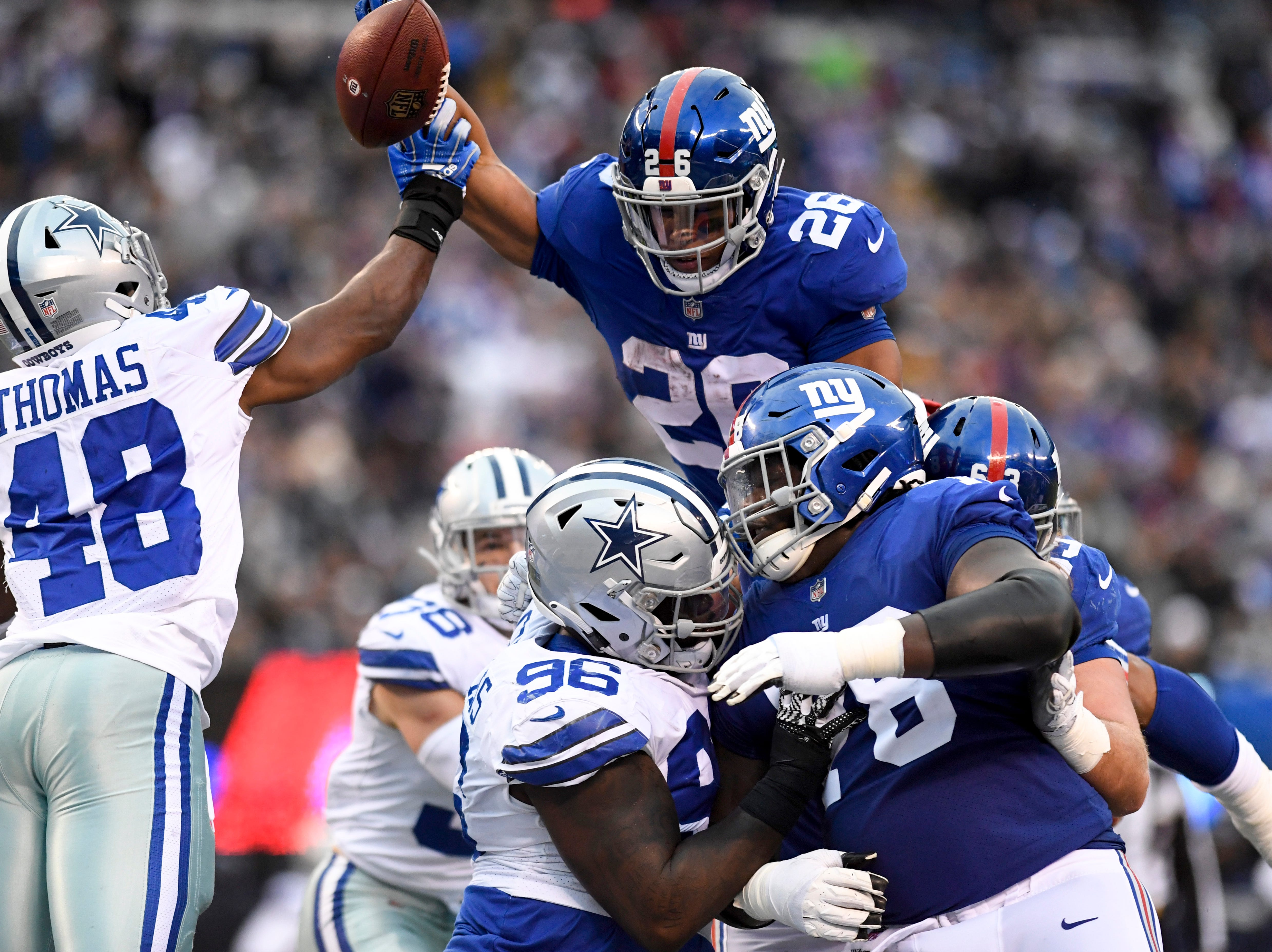 New York Giants running back Saquon Barkley (26) leaps into the endzone for a touchdown in the fourth quarter. The New York Giants lose to the Dallas Cowboys 36-35 on Sunday, Dec. 30, 2018, in East Rutherford.