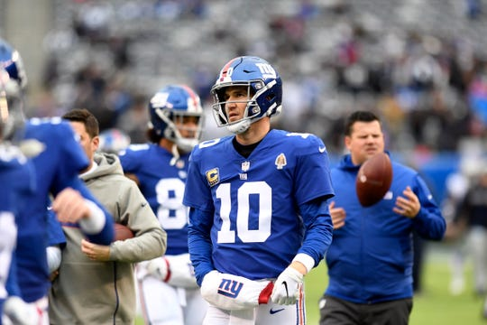 New York Giants quarterback Eli Manning (10) on the field for warmups. The New York Giants face the Dallas Cowboys in the last regular season game on Sunday, Dec. 30, 2018, in East Rutherford.