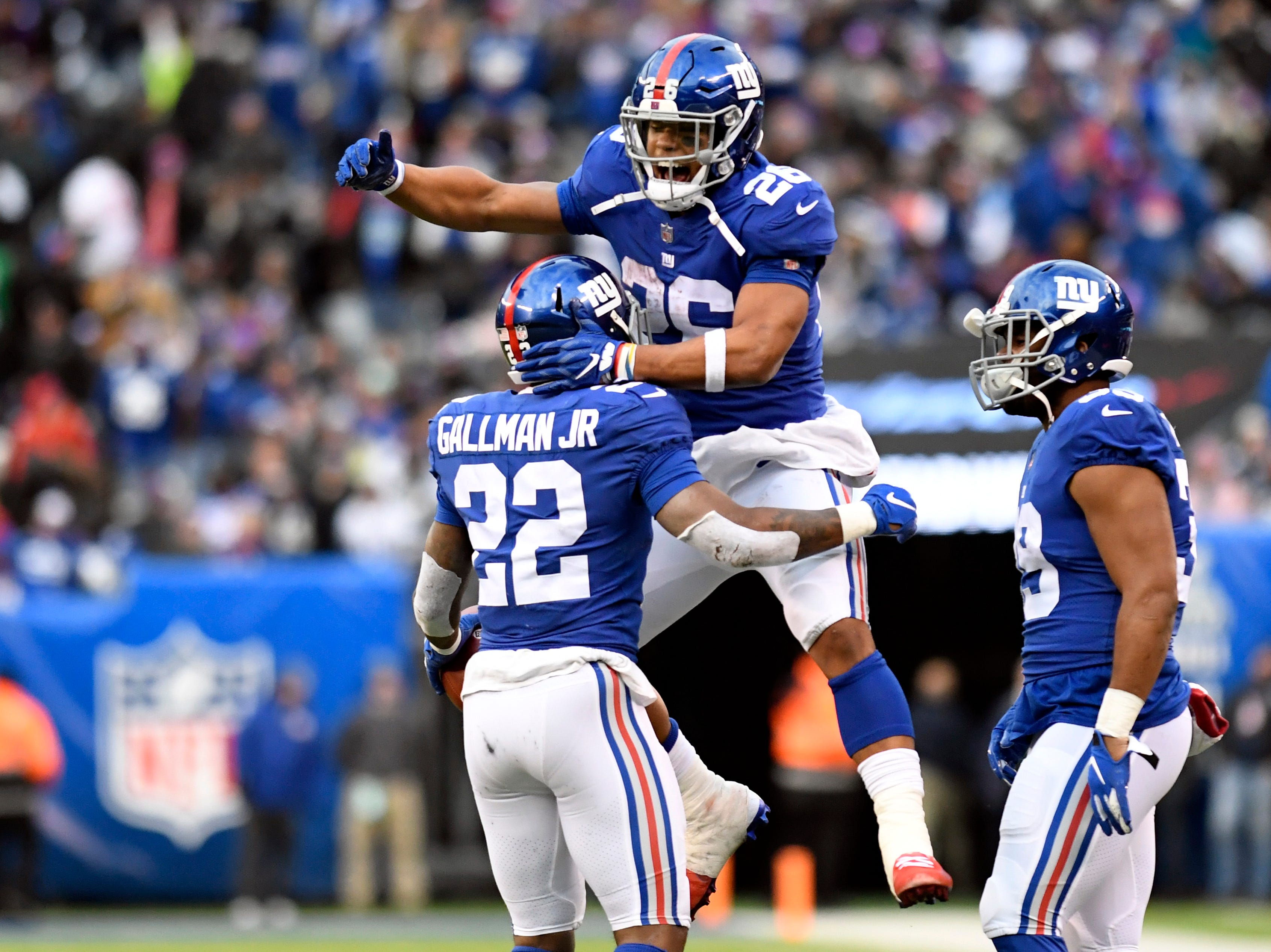 New York Giants running back Saquon Barkley (26) celebrates Wayne Gallman's (22) touchdown in the fourth quarter. The New York Giants lose to the Dallas Cowboys 36-35 on Sunday, Dec. 30, 2018, in East Rutherford.