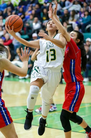 Mayfield High School's Raena Tesillo takes a shot on Saturday, Dec. 29, 2018, during the Holiday Hoopla Championship game at MHS.