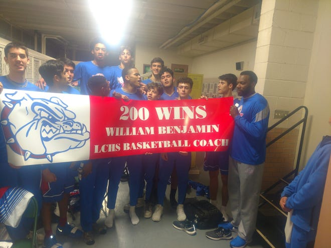 Las Cruces High School beat El Paso Coronado 68-65 on Saturday in the Holiday Hoopla championship game. Saturday was also the 200th win for Bulldawgs head coach William Benjamin.