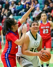 Mayfield High School's Marisa Rosales looks for a shot under the basket on Saturday, Dec. 29, 2018, during the Holiday Hoopla Championship game at MHS.