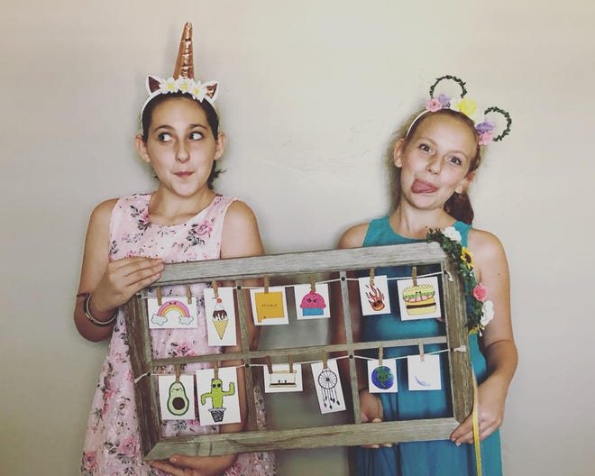 Sadie and Jaiden's business is Polka Dot Boutique. They sell hair accessories, hand-drawn decals and dreamcatchers.
