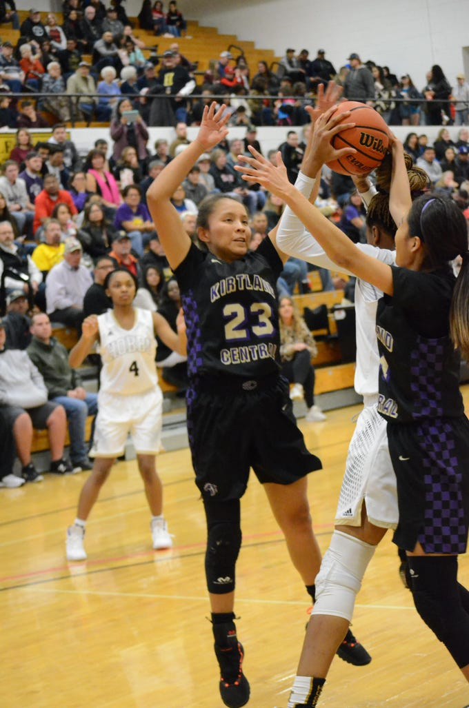 Kirtland Central's Avery Begay looks to deflect a pass against Hobbs during Saturday's Hobbs Holiday Tournament championship game at Tasker Arena.