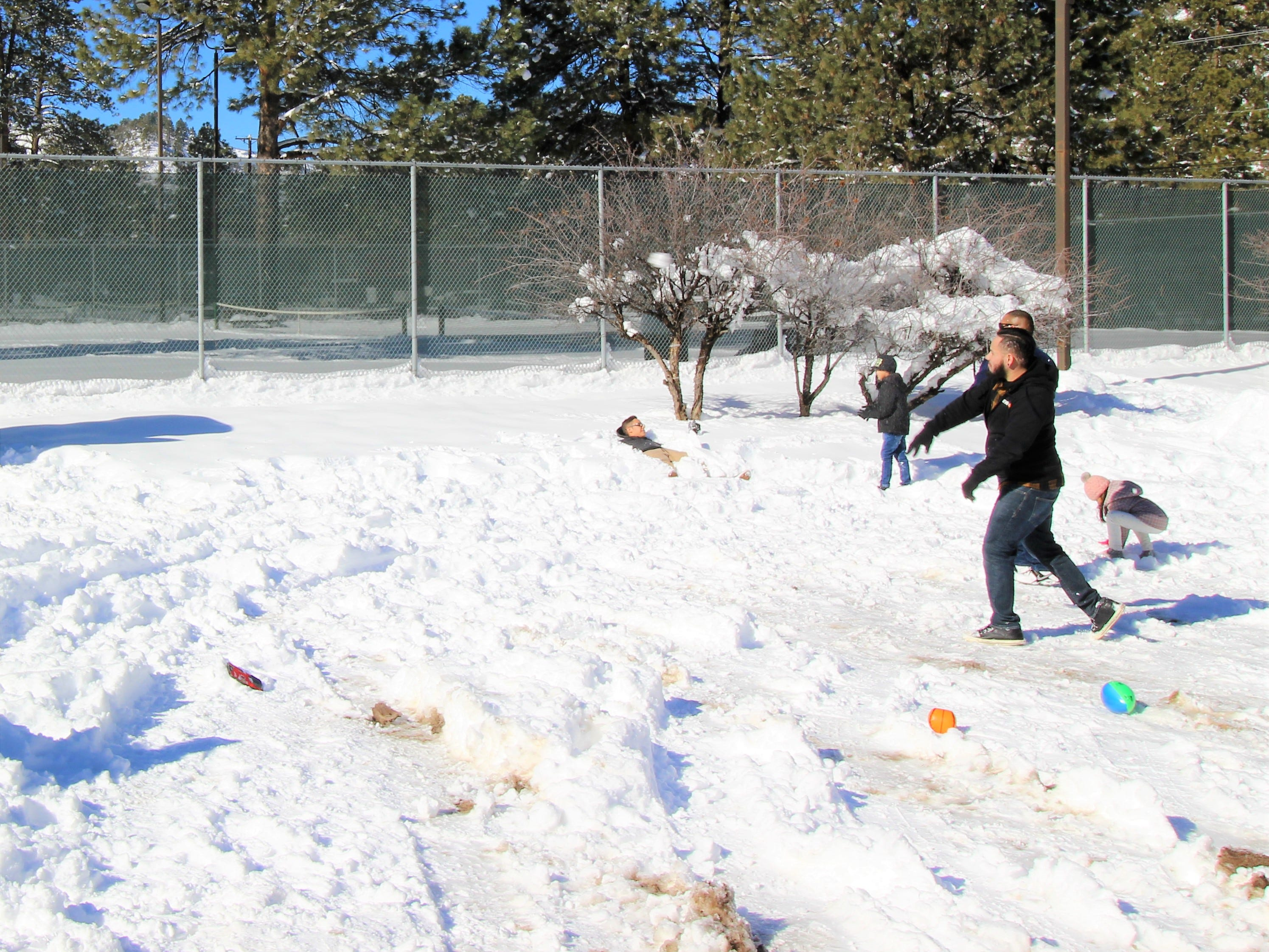 A family from Texas stops by School House Park to have a snow ball fight and bury a friend up to his neck in snow after the Village received over two feet of snow.