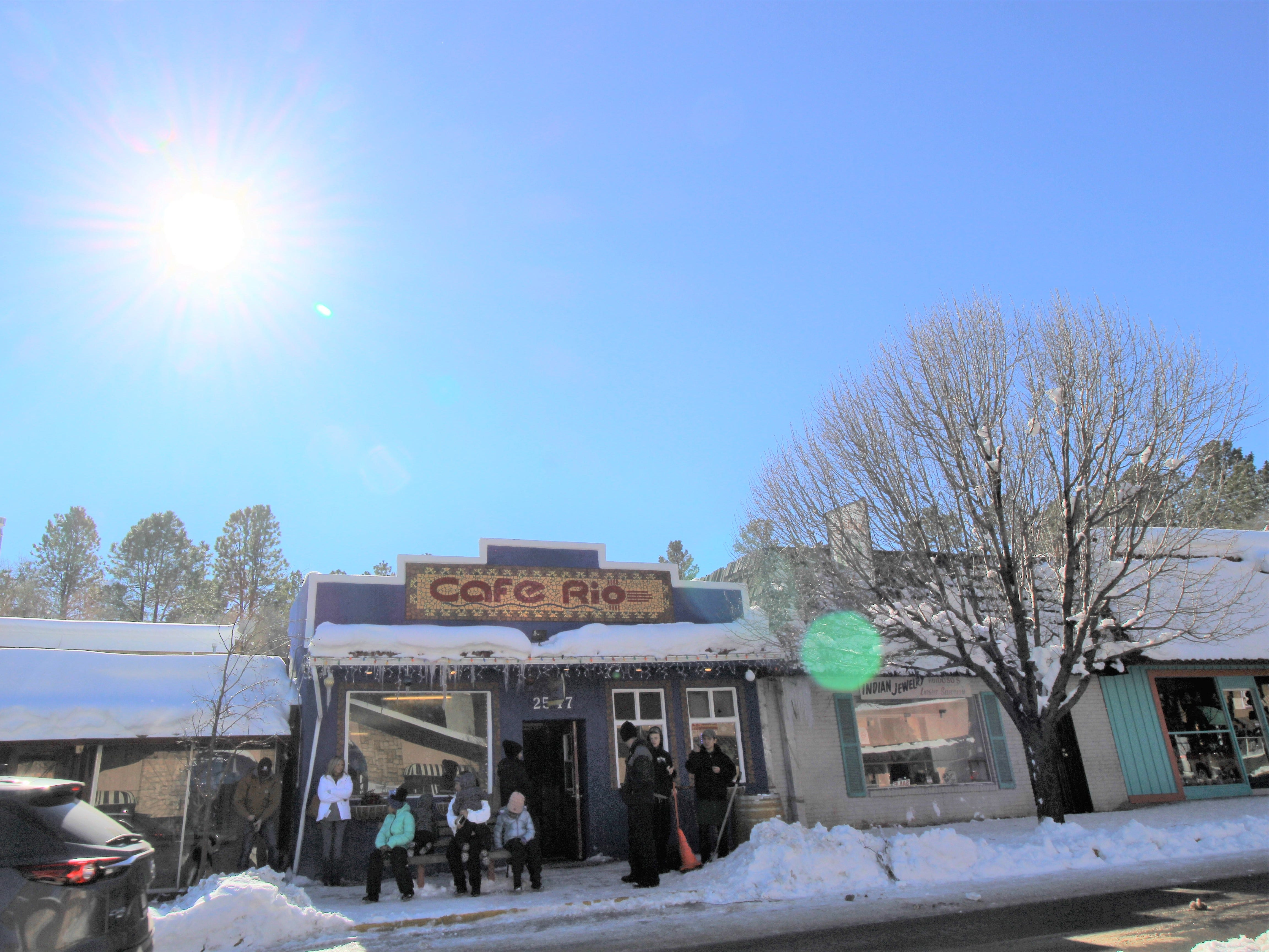 Sleet, snow, nor ice kept visitors from hitting midtown Ruidoso after a major snow storm.