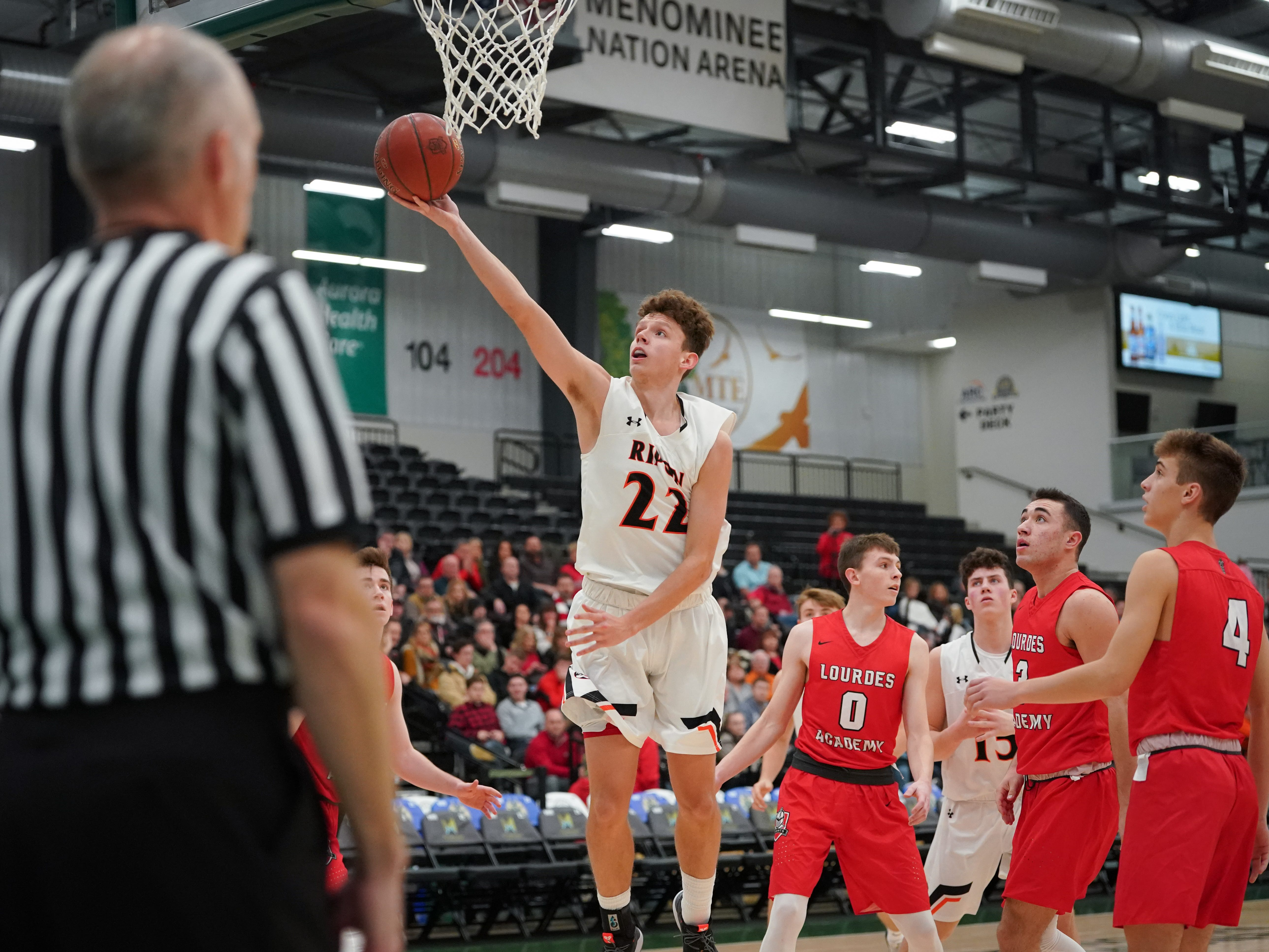 Max Beuthin (22) of Ripon goes up for a layup. The Lourdes Knights and Ripon Tigers met in a nonconference basketball game Saturday afternoon, December 29, 2018 at the Menomonie Nation Arena in Oshkosh.