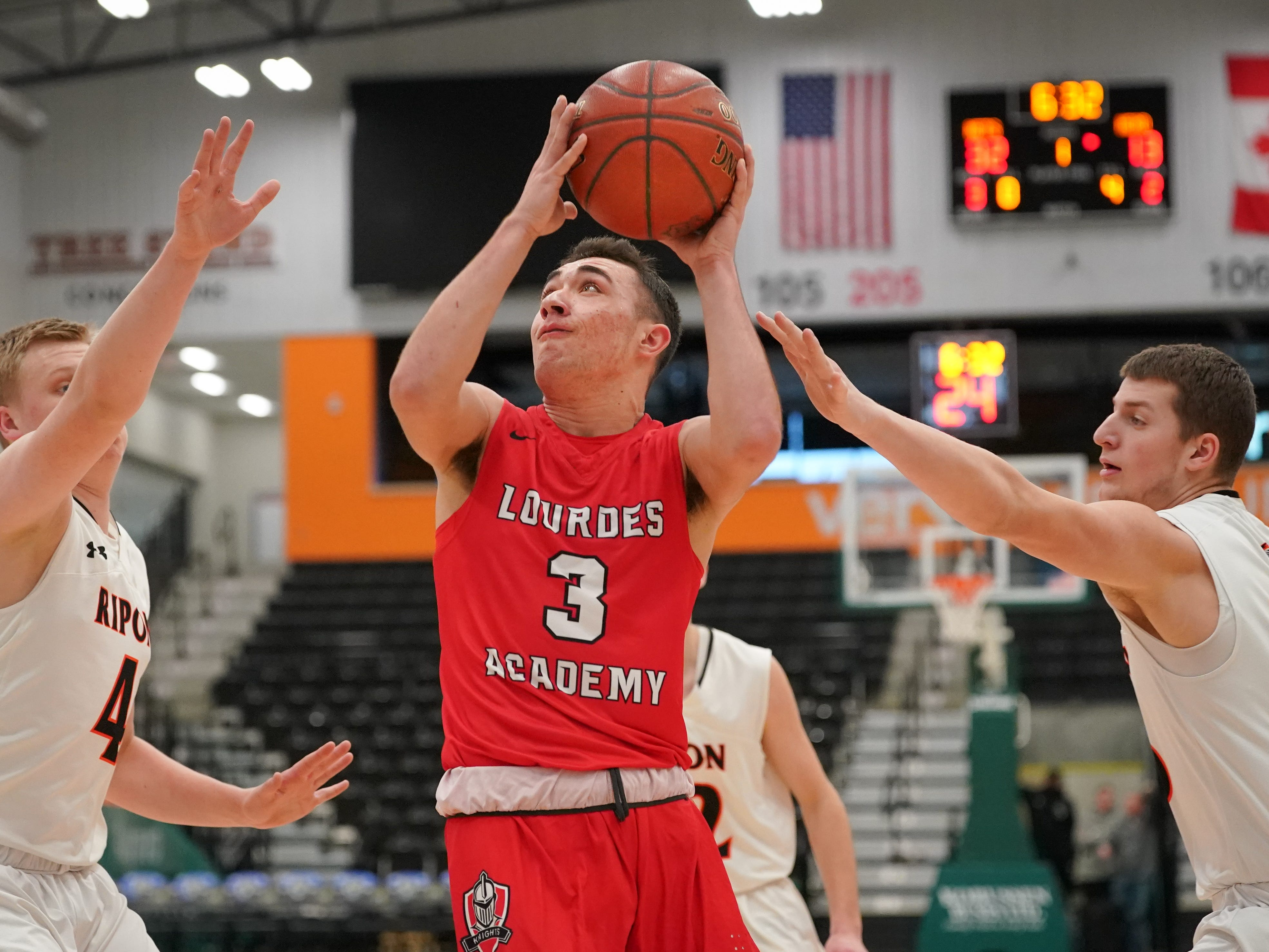 Ben Huizenga (3) of Lourdes goes in for a shot. The Lourdes Knights and Ripon Tigers met in a nonconference basketball game Saturday afternoon, December 29, 2018 at the Menomonie Nation Arena in Oshkosh.