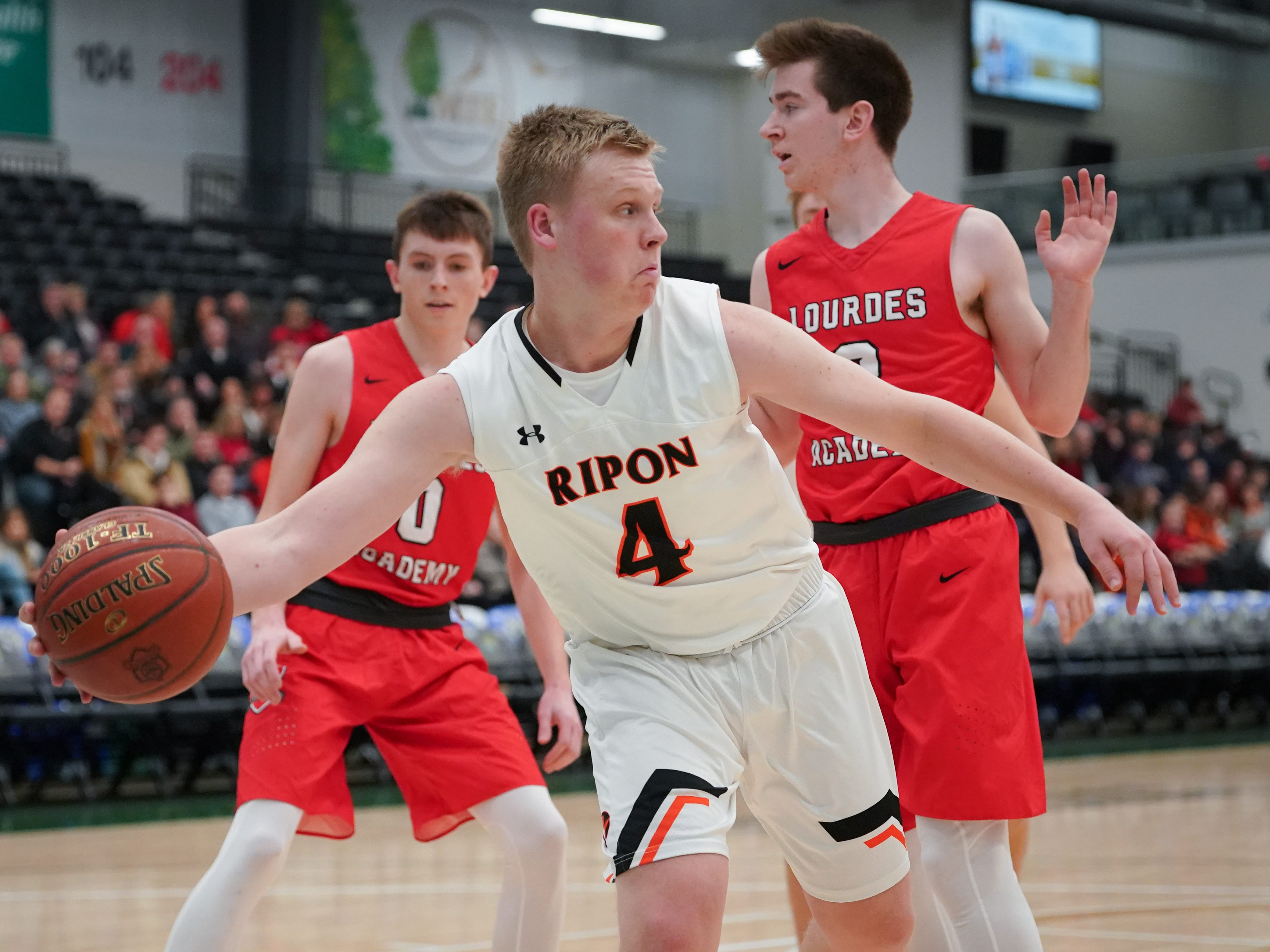 Hunter Auchtung (4) of Ripon grabs a rebound. The Lourdes Knights and Ripon Tigers met in a nonconference basketball game Saturday afternoon, December 29, 2018 at the Menomonie Nation Arena in Oshkosh.