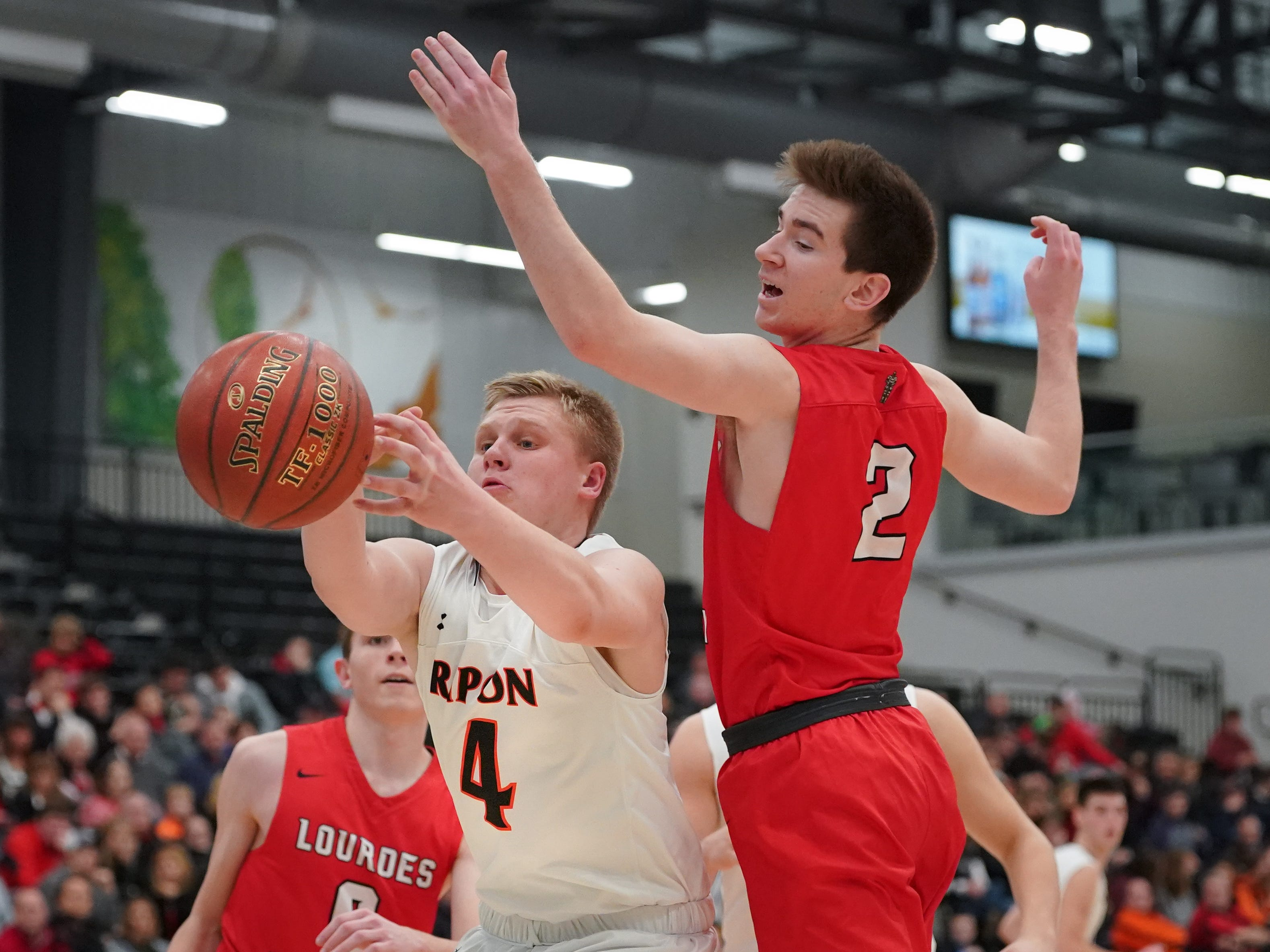 Hunter Auchtung (4) of Ripon battles Henry Noone (2) of Lourdes for a rebound. The Lourdes Knights and Ripon Tigers met in a nonconference basketball game Saturday afternoon, December 29, 2018 at the Menomonie Nation Arena in Oshkosh.