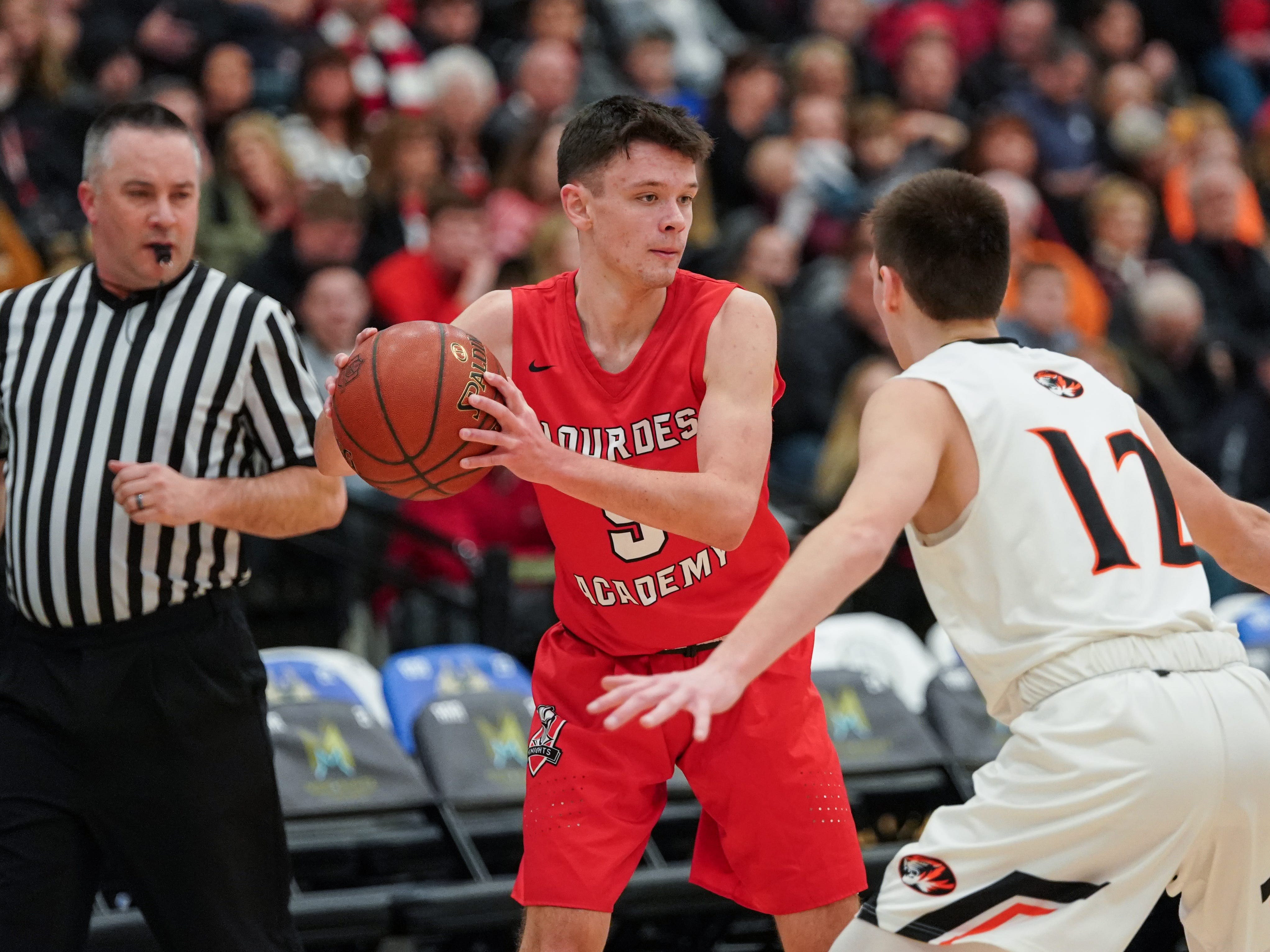 Jack McKellips (5) of Lourdes looks for room to pass. The Lourdes Knights and Ripon Tigers met in a non-conference basketball game Saturday afternoon, December 29, 2018 at the Menomonie Nation Arena in Oshkosh.