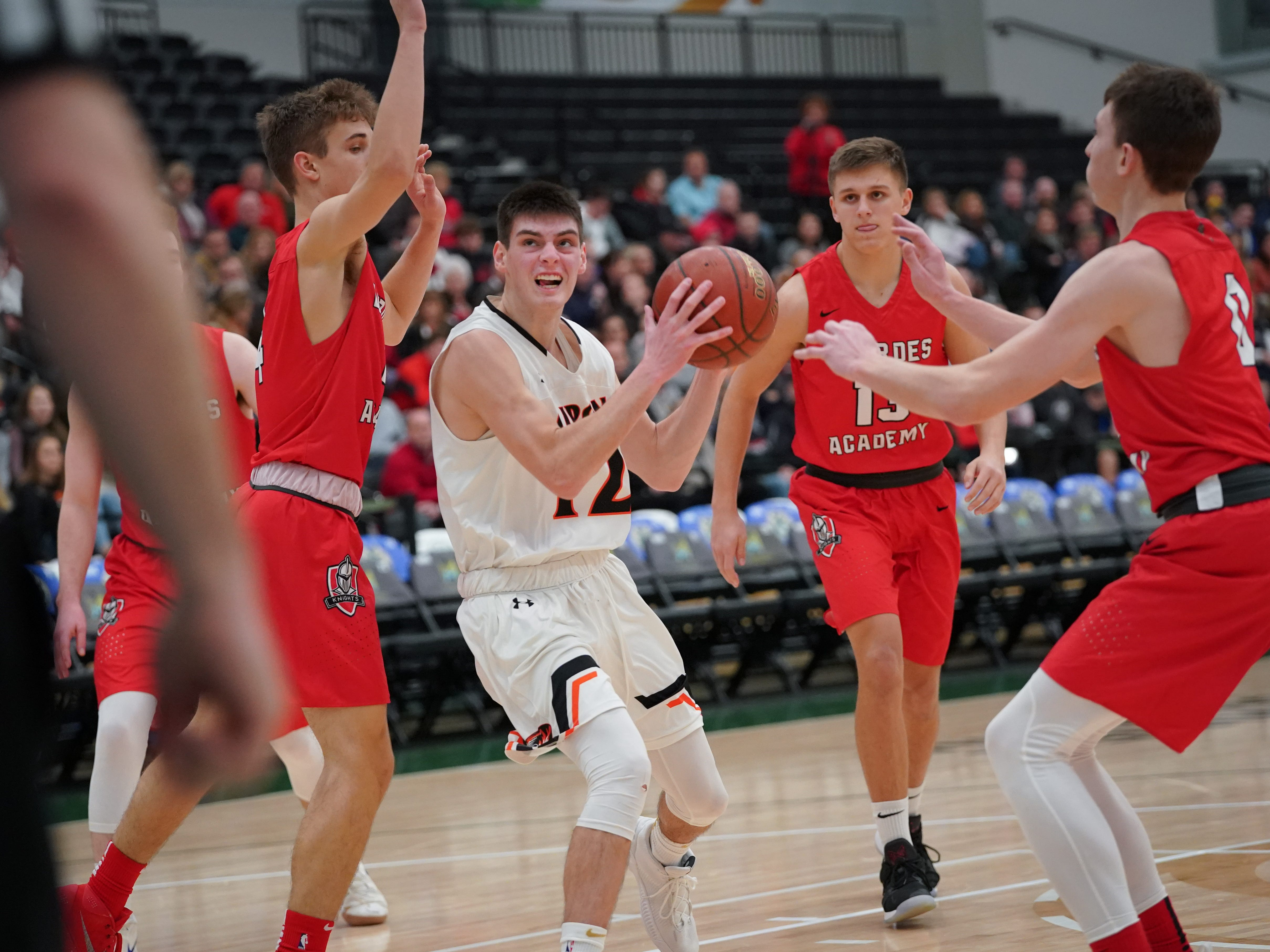 Luke Rogers (12) of Ripon drives in to the basket. The Lourdes Knights and Ripon Tigers met in a nonconference basketball game Saturday afternoon, December 29, 2018 at the Menomonie Nation Arena in Oshkosh.