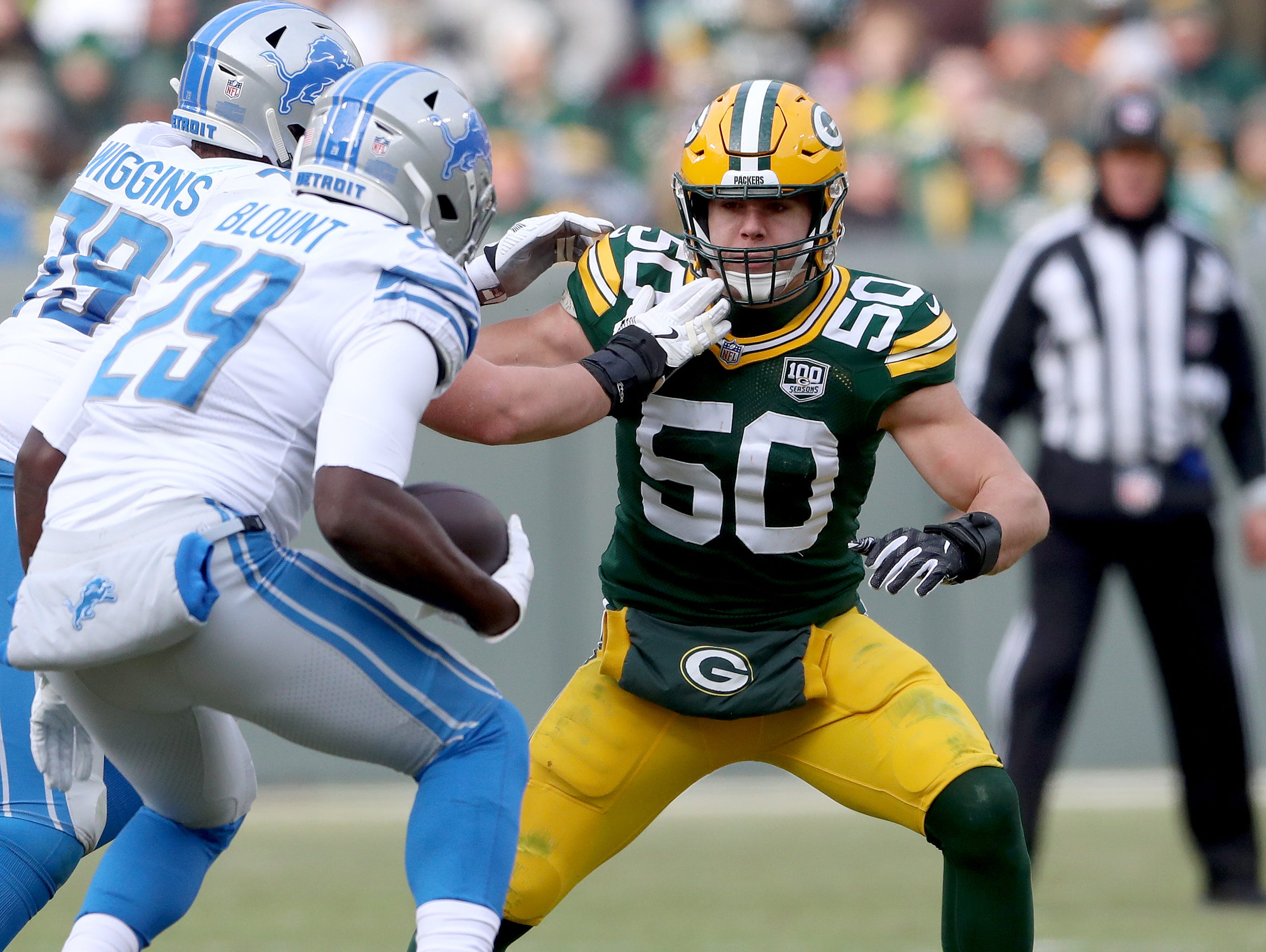 Green Bay Packers inside linebacker Blake Martinez (50) looks to tackle running back LeGarrette Blount (29) against the Detroit Lions at Lambeau Field Sunday, December 30, 2018 in Green Bay, Wis.
