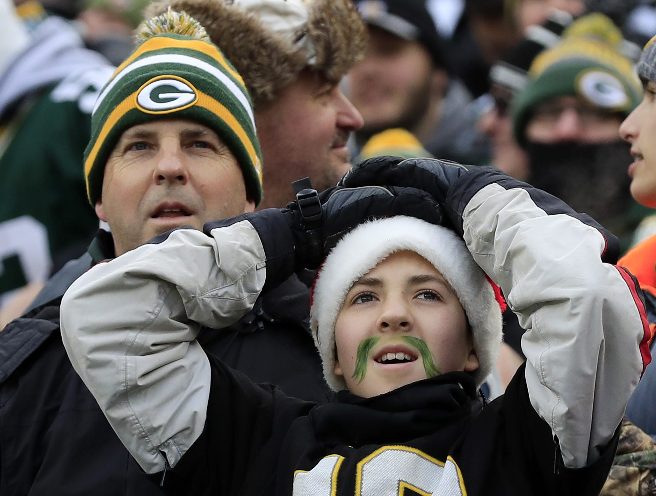 A Packers fan reacts after a turnover on downs against the Detroit Lions in the fourth quarter at Lambeau Field on Sunday, December 30, 2018 in Green Bay, Wis. Adam Wesley/USA TODAY NETWORK-Wis