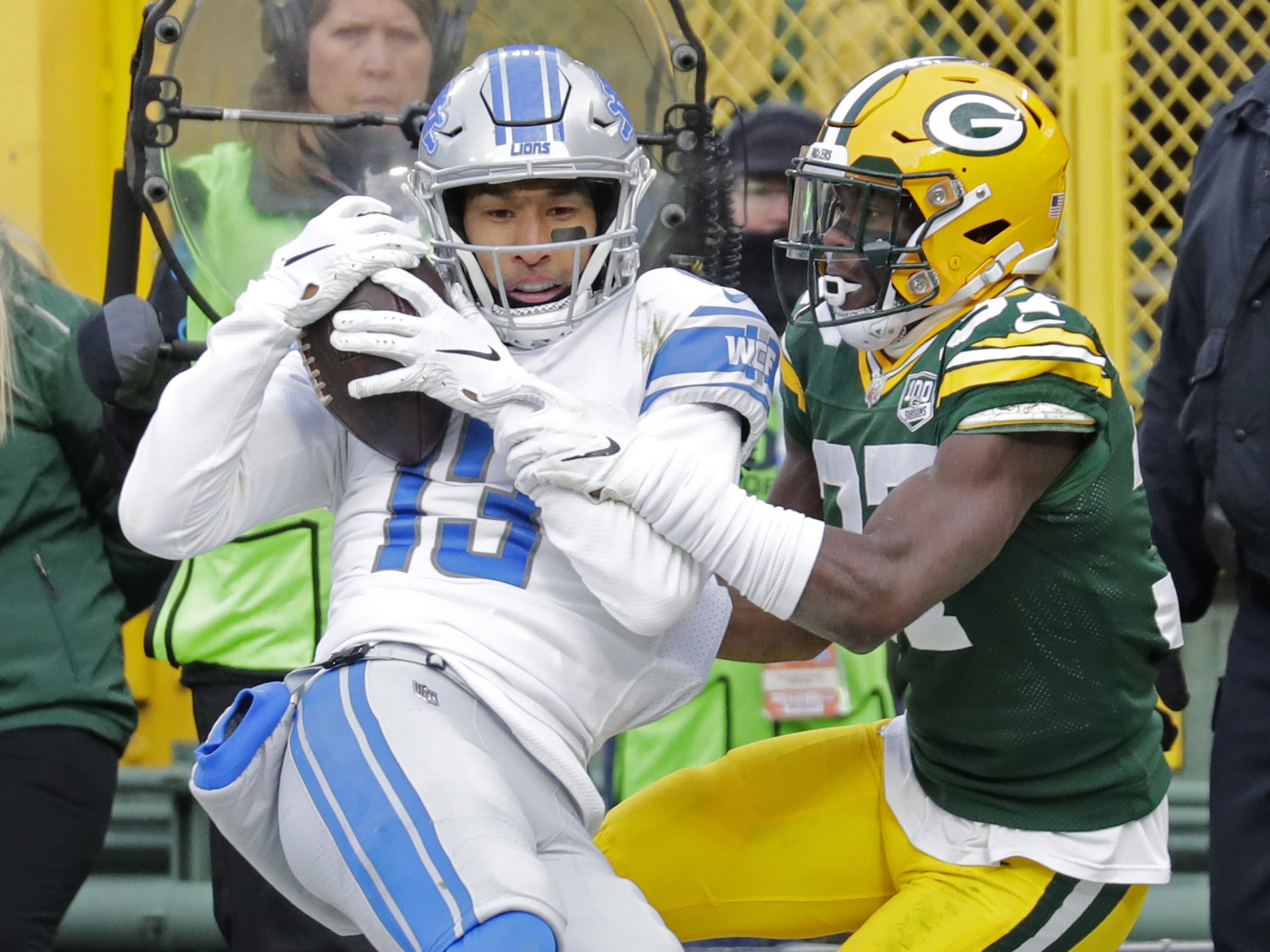 Detroit Lions wide receiver T.J. Jones (13) pulls down a touchdown against Green Bay Packers cornerback Josh Jackson (37) in the fourth quarter Sunday, December 30, 2018, at Lambeau Field in Green Bay, Wis.  Dan Powers/USA TODAY NETWORK-Wisconsin