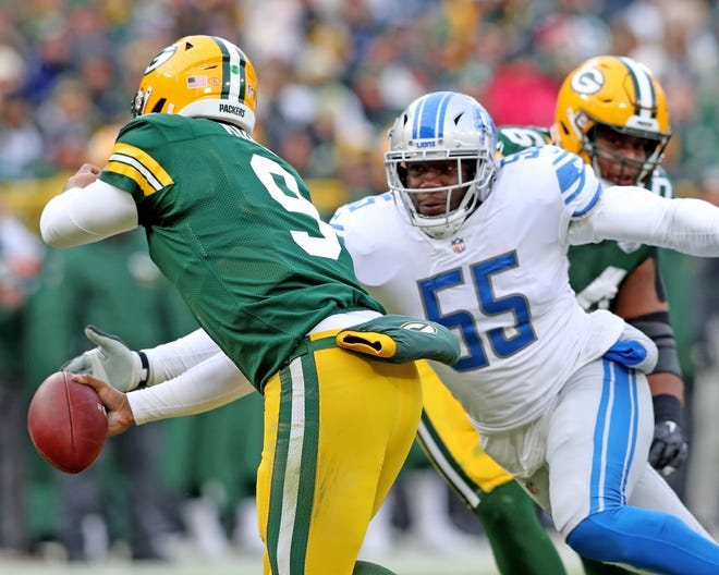Green Bay Packers quarterback DeShone Kizer (9) tries to escape the rush of defensive end Eric Lee (55) against the Detroit Lions at Lambeau Field Sunday, December 30, 2018 in Green Bay, Wis.