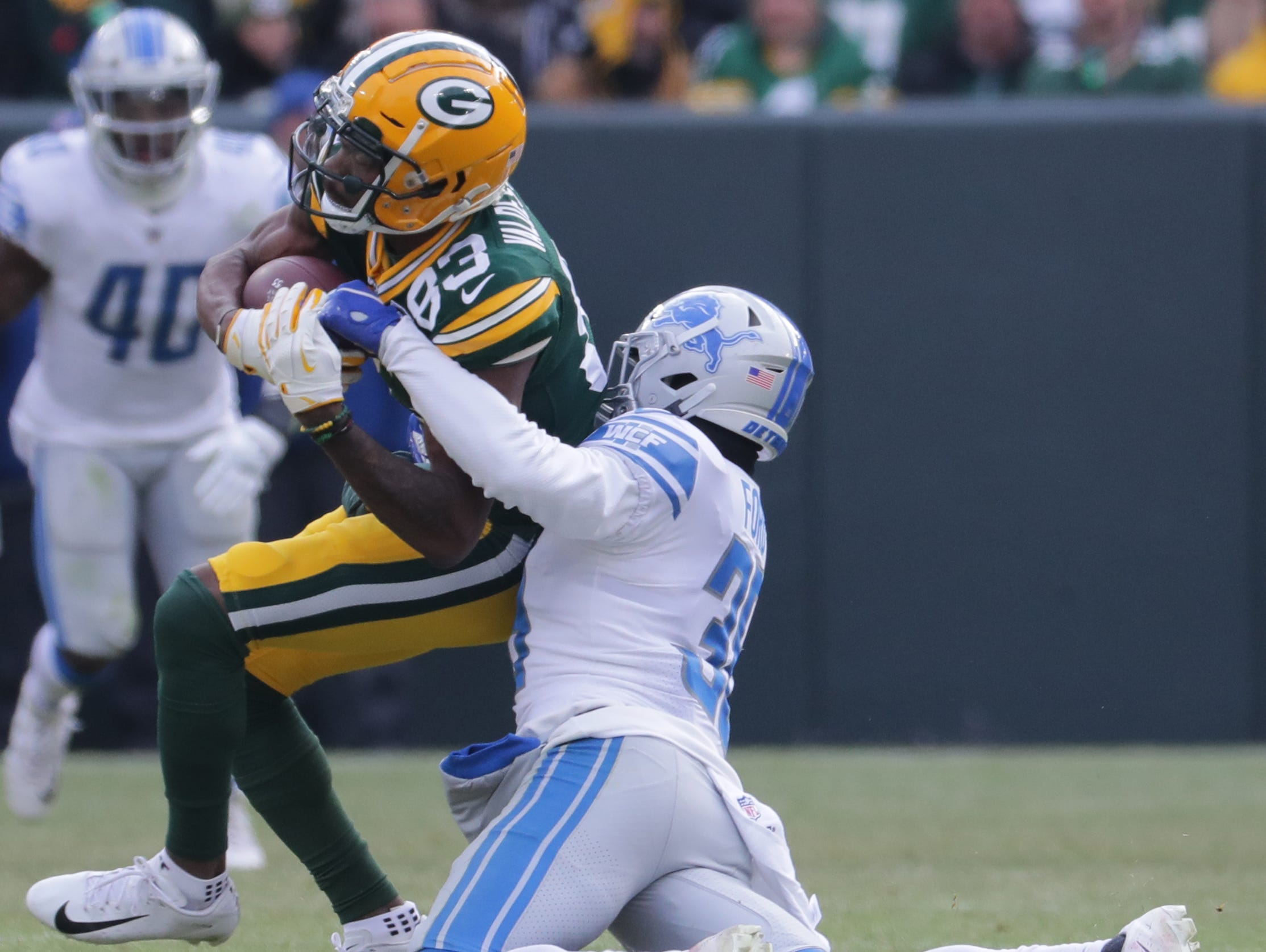 Green Bay Packers wide receiver Marquez Valdes-Scantling (83) makes. Catch for a first before being tackled by Detroit Lions cornerback Mike Ford (38) during the second quarter of their game Sunday, December 30, 2018 at Lambeau Field in Green Bay, Wis. The Detroit Lions beat the Green Bay Packers 31-0.  MARK HOFFMAN/MILWAUKEE JOURNAL SENTINEL