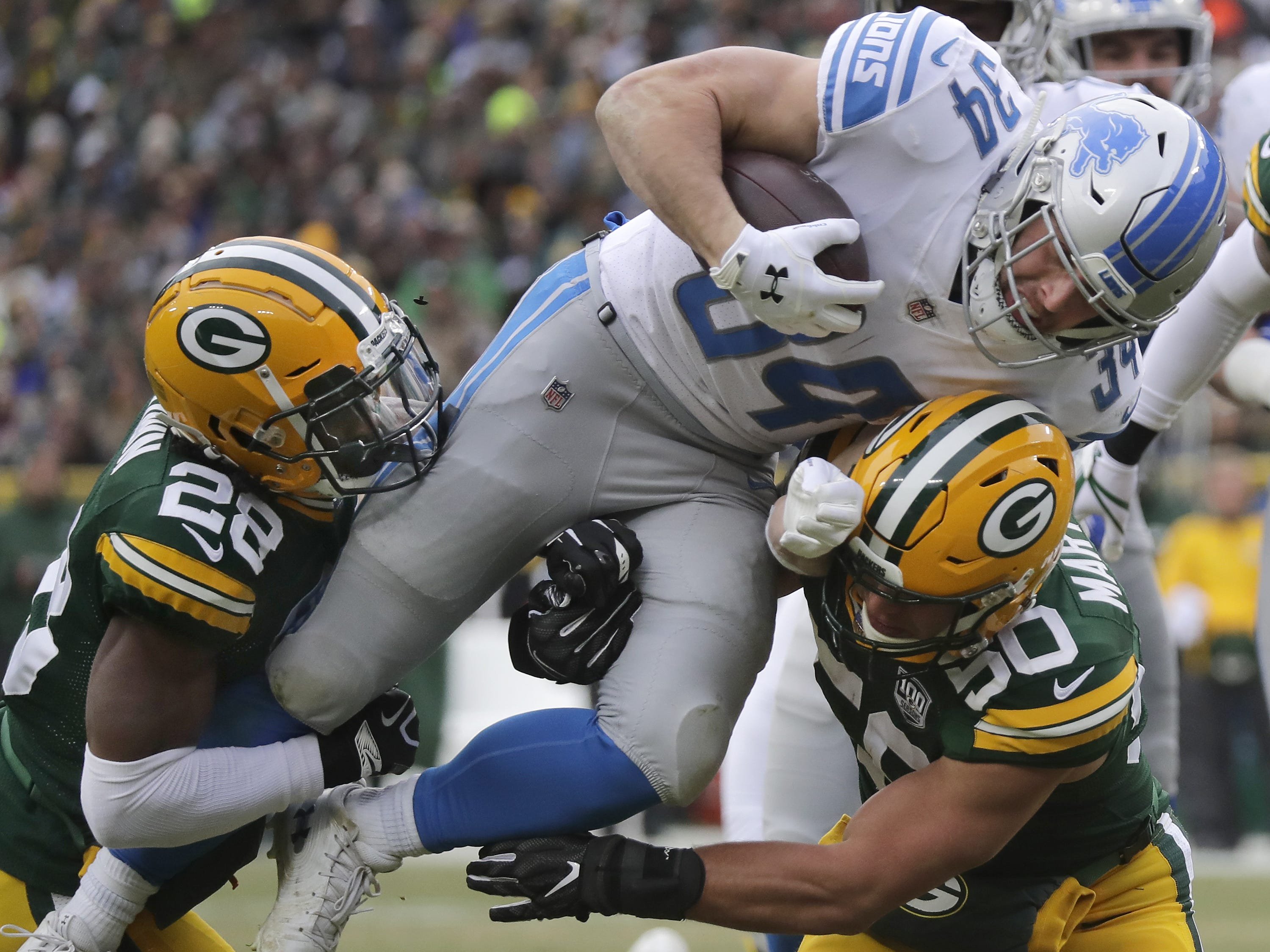Green Bay Packers defensive back Tony Brown and Blake Martinez make a stop of Detroit Lions running back Zach Zenner on the goal line in the first half of their football game on Sunday, December 30, 2018, at Lambeau Field in Green Bay, Wis. Wm. Glasheen/USA TODAY NETWORK-Wisconsin.
