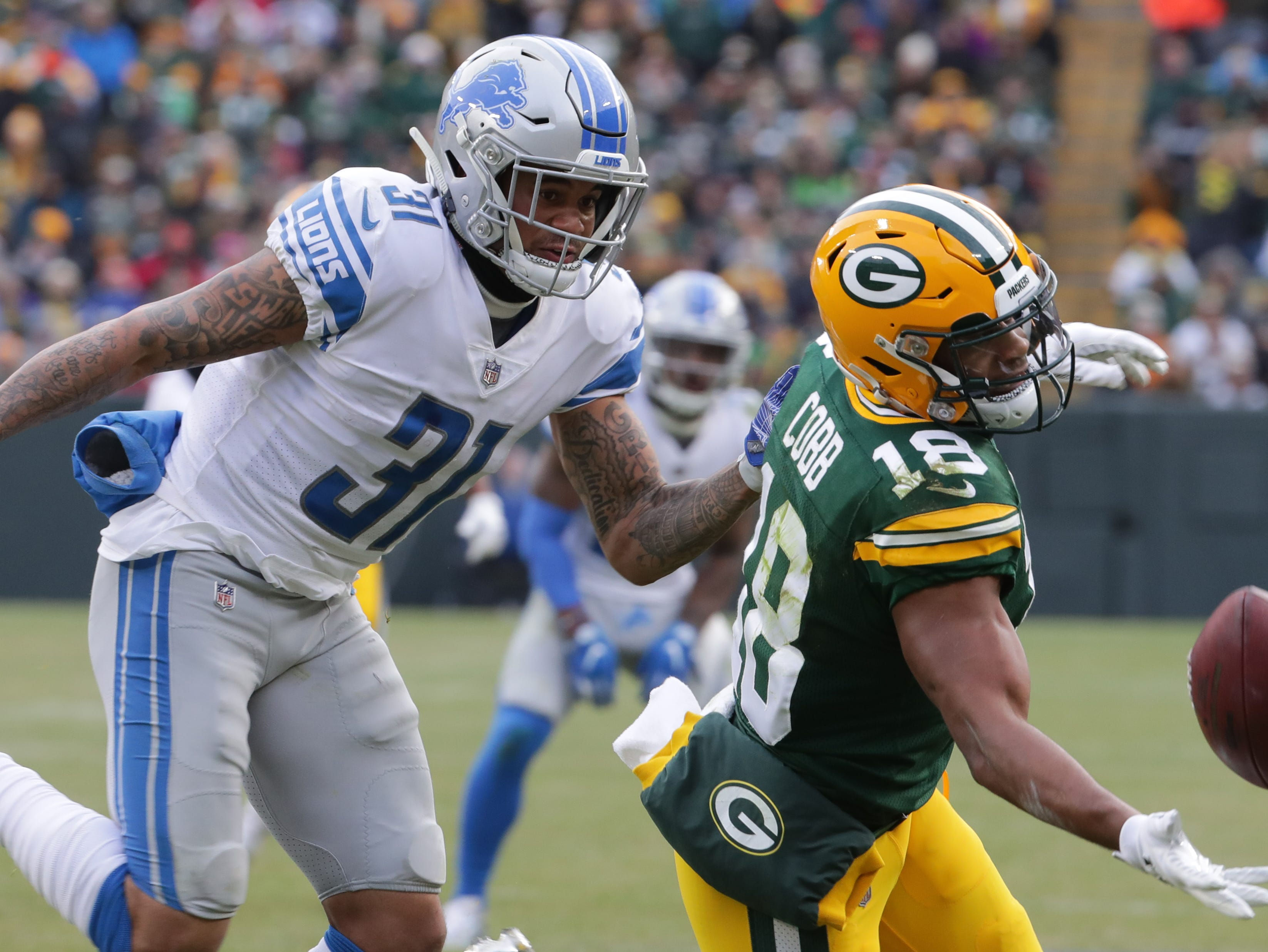 Green Bay Packers wide receiver Randall Cobb (18) is unable reel in a catch while being covered by Detroit Lions cornerback Teez Tabor (31) during the fourth quarter of their game Sunday, December 30, 2018 at Lambeau Field in Green Bay, Wis. The Detroit Lions beat the Green Bay Packers 31-0.  MARK HOFFMAN/MILWAUKEE JOURNAL SENTINEL