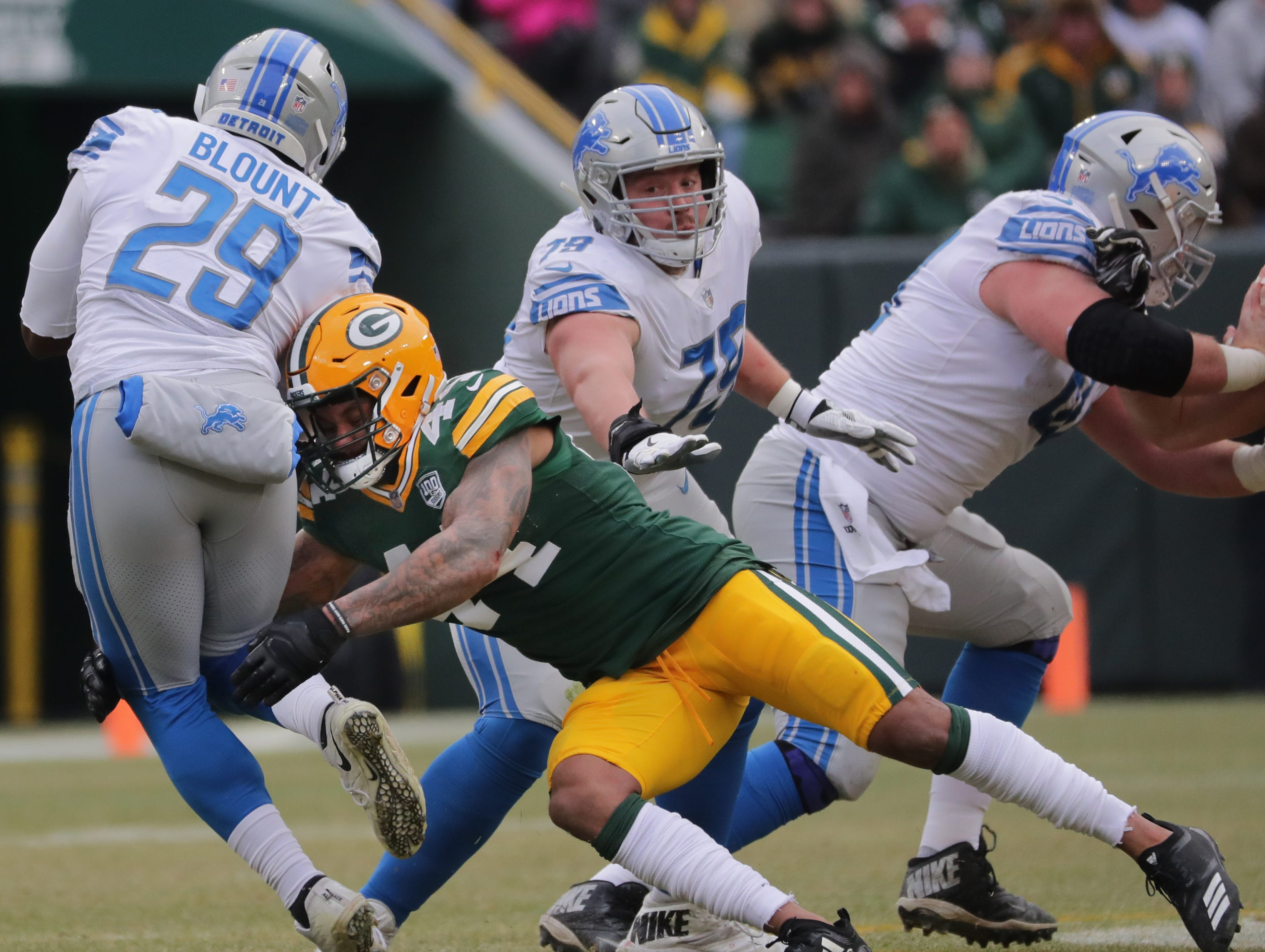Green Bay Packers inside linebacker Antonio Morrison (44) tackles Detroit Lions running back LeGarrette Blount (29) for a loss during the second quarter of their game Sunday, December 30, 2018 at Lambeau Field in Green Bay, Wis. The Detroit Lions beat the Green Bay Packers 31-0.  MARK HOFFMAN/MILWAUKEE JOURNAL SENTINEL