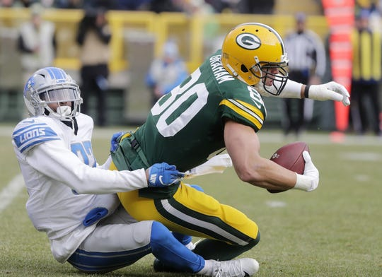 Green Bay Packers tight end Jimmy Graham (80) is tackled short of a first down by Detroit Lions defensive back Tavon Wilson (32) at Lambeau Field on Sunday, December 30, 2018 in Green Bay, Wis. Adam Wesley/USA TODAY NETWORK-Wis