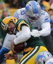 Detroit Lions defensive end Romeo Okwara (95) sacks Green Bay Packers quarterback Aaron Rodgers (12) during the first quarter of their game Sunday, December 30, 2018 at Lambeau Field in Green Bay, Wis.  MARK HOFFMAN/MILWAUKEE JOURNAL SENTINEL