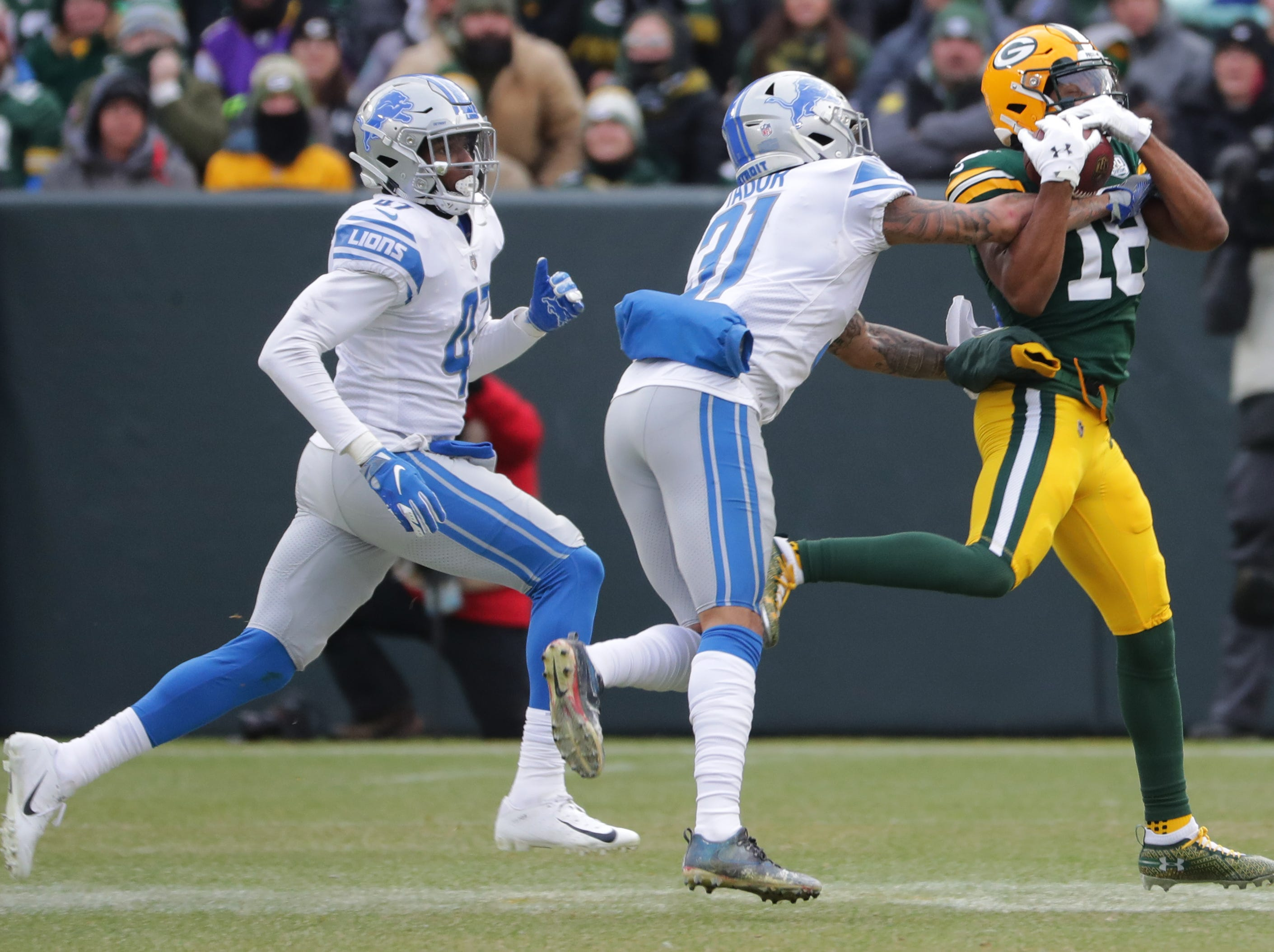 Green Bay Packers wide receiver Randall Cobb (18) snares a 27-yard reception while benign covered by Detroit Lions cornerback Teez Tabor (31) during the fourth quarter of their game Sunday, December 30, 2018 at Lambeau Field in Green Bay, Wis. The Detroit Lions beat the Green Bay Packers 31-0.  MARK HOFFMAN/MILWAUKEE JOURNAL SENTINEL