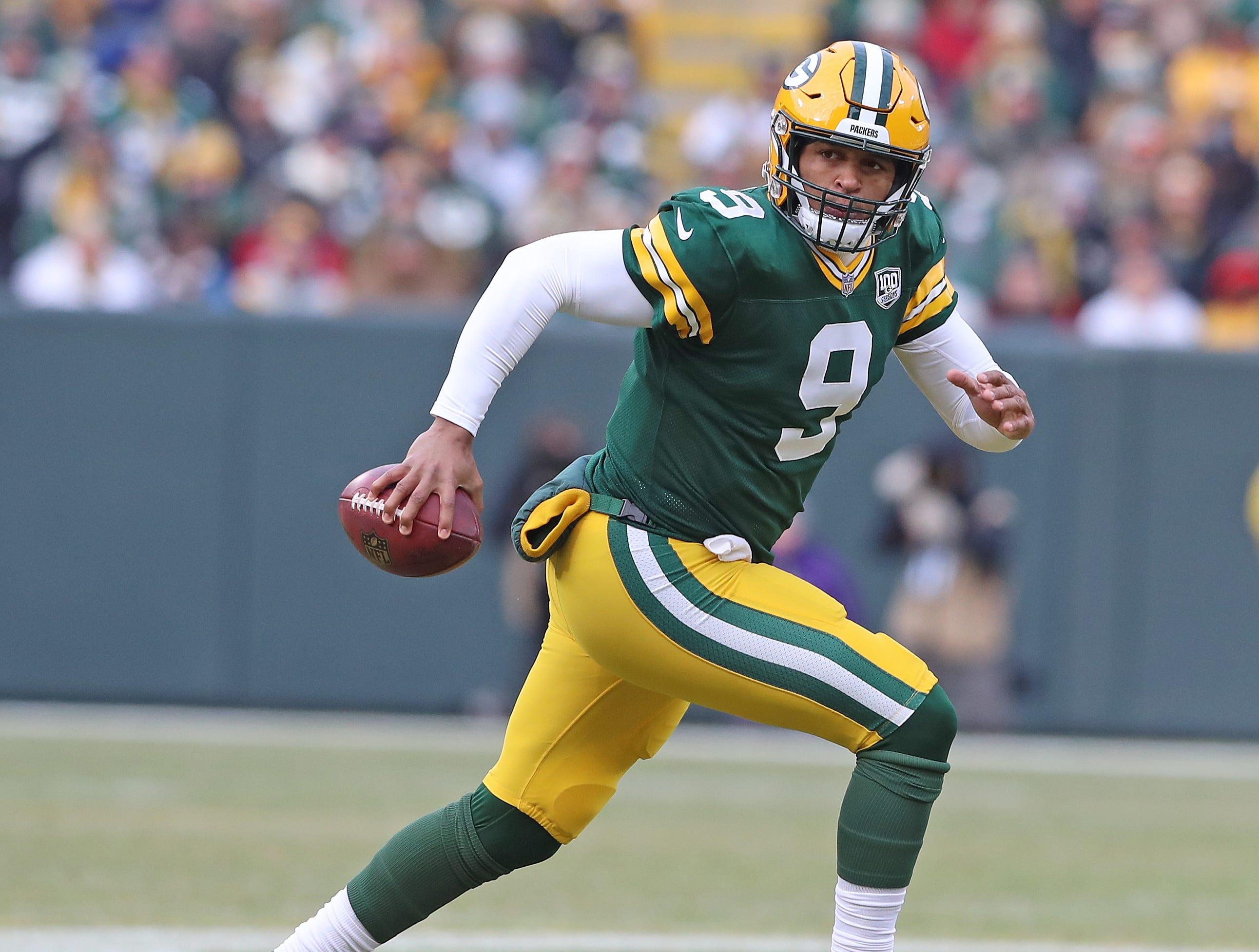 Green Bay Packers quarterback DeShone Kizer (9) scrambles against the Detroit Lions at Lambeau Field Sunday, December 30, 2018 in Green Bay, Wis.
