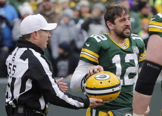 Green Bay Packers quarterback Aaron Rodgers (12) retrieves his helmet after being sacked in the first quarter against the Detroit Lions at Lambeau Field on Sunday, December 30, 2018 in Green Bay, Wis. Adam Wesley/USA TODAY NETWORK-Wis