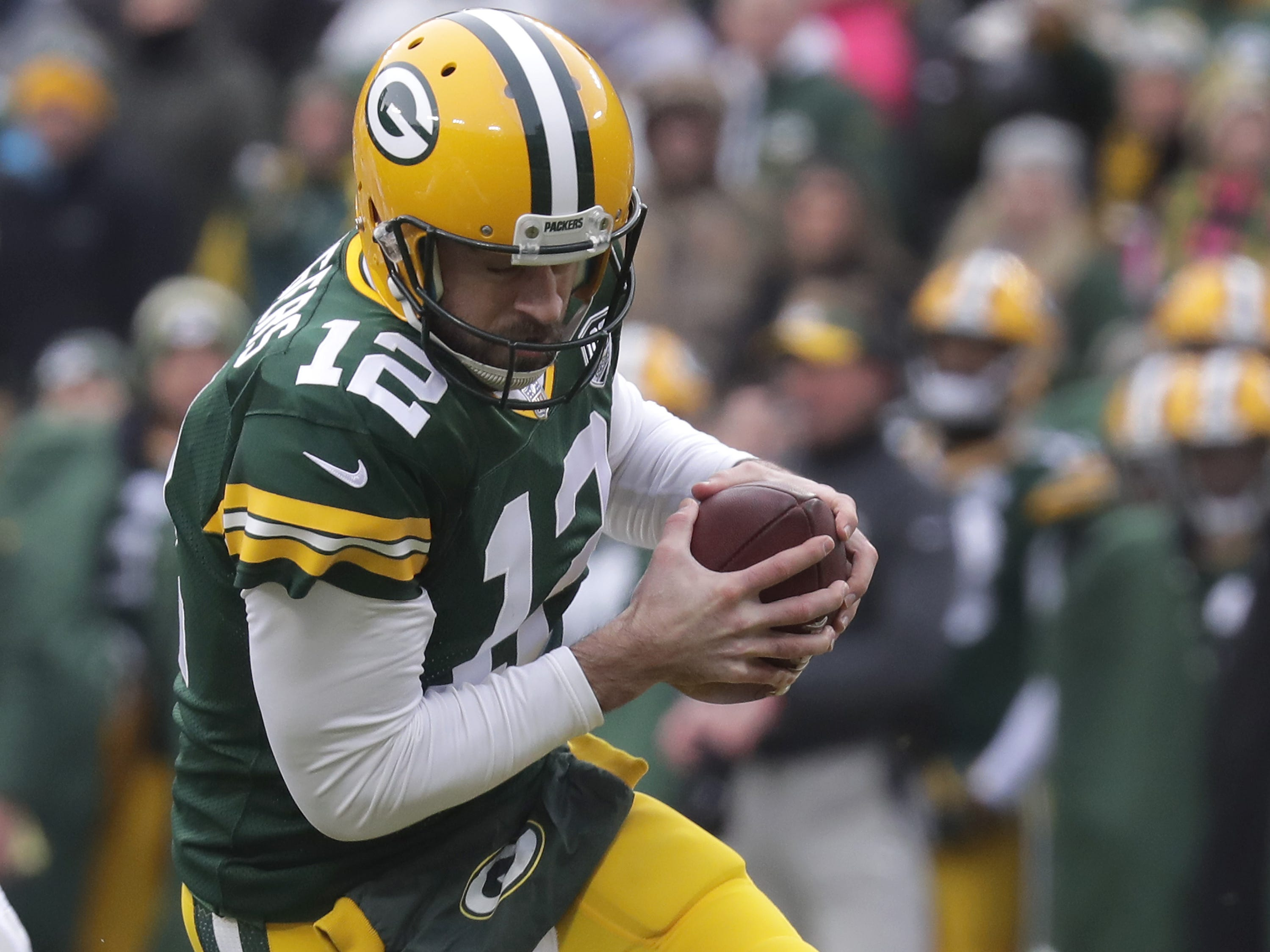 Detroit Lions Jarrad Davis chases Green Bay Packers quarterback Aaron Rodgers in the firest quarter during their football game on Sunday, December 30, 2018, at Lambeau Field in Green Bay, Wis. Wm. Glasheen/USA TODAY NETWORK-Wisconsin.